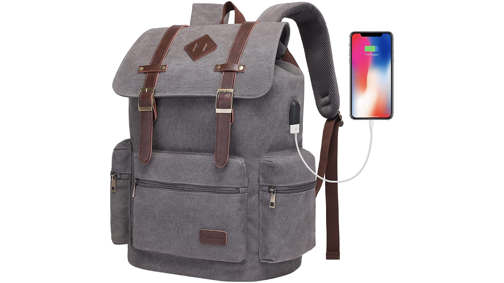 a gray backpack with leather straps, buckles, zippered outer pockets, and a phone plugged into a charger