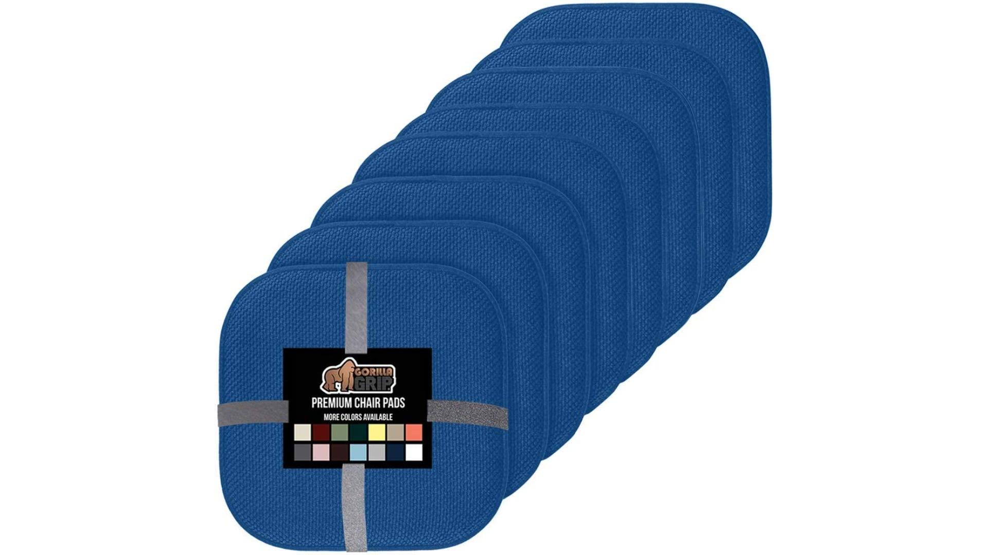 A row of eight indigo square seat cushions.