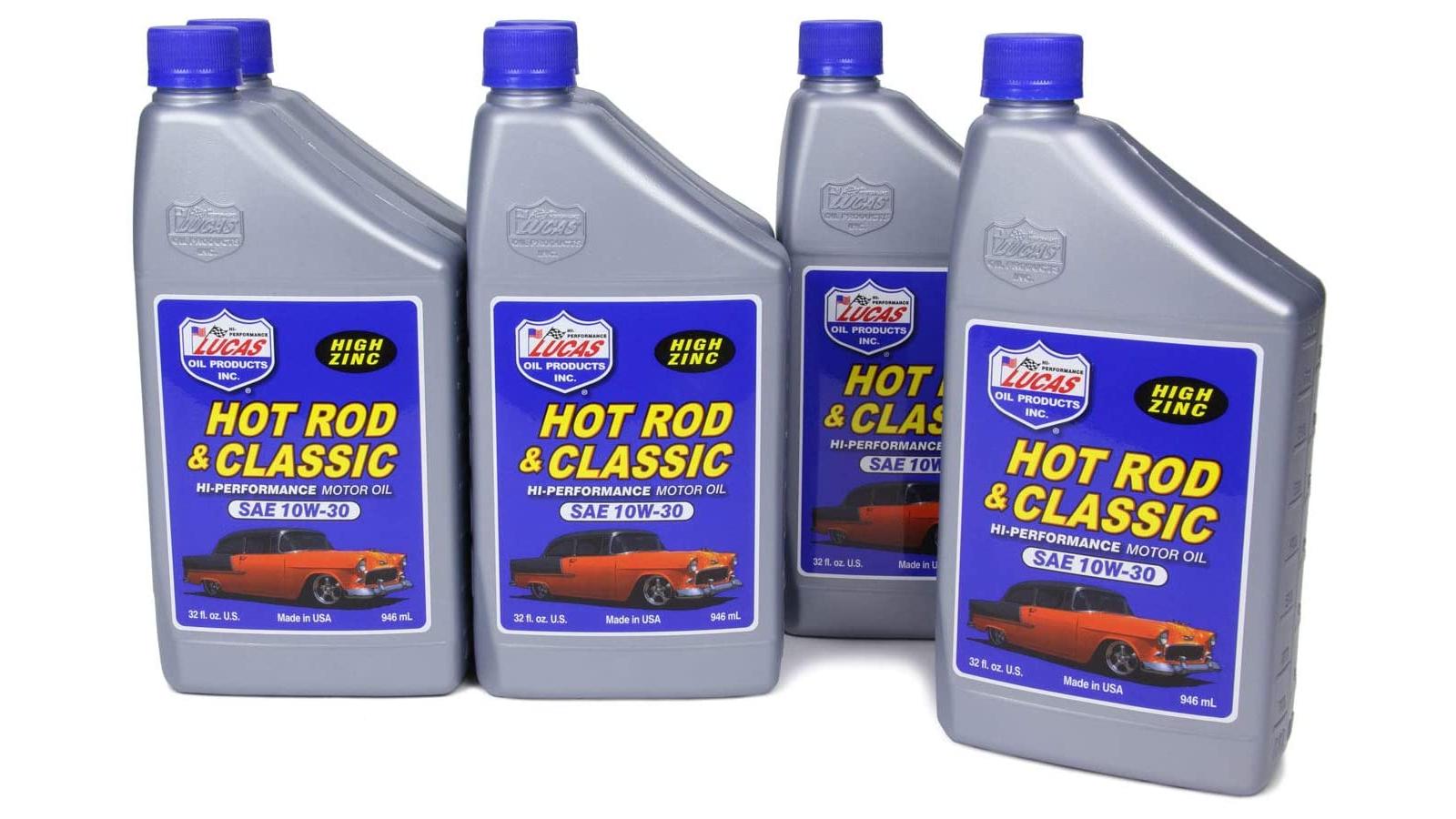 Four silver bottles of Lucas motor oil.