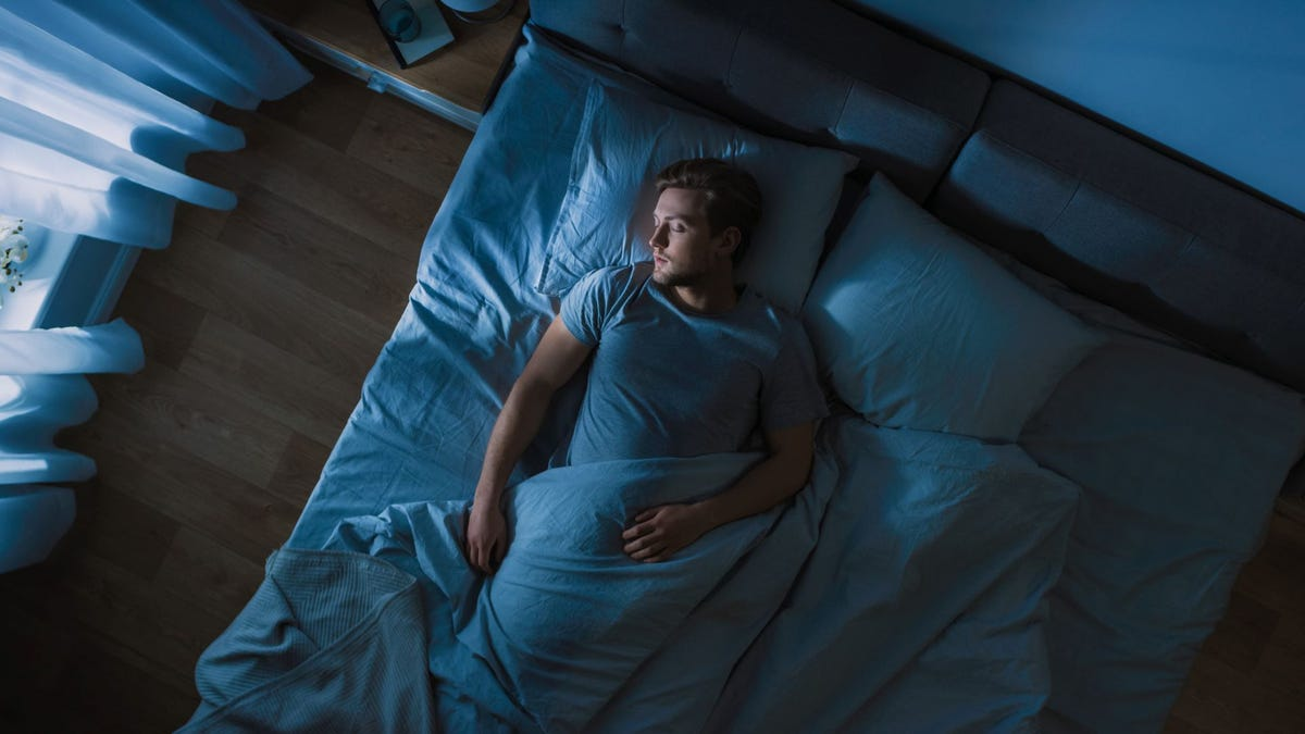 A man asleep in bed.