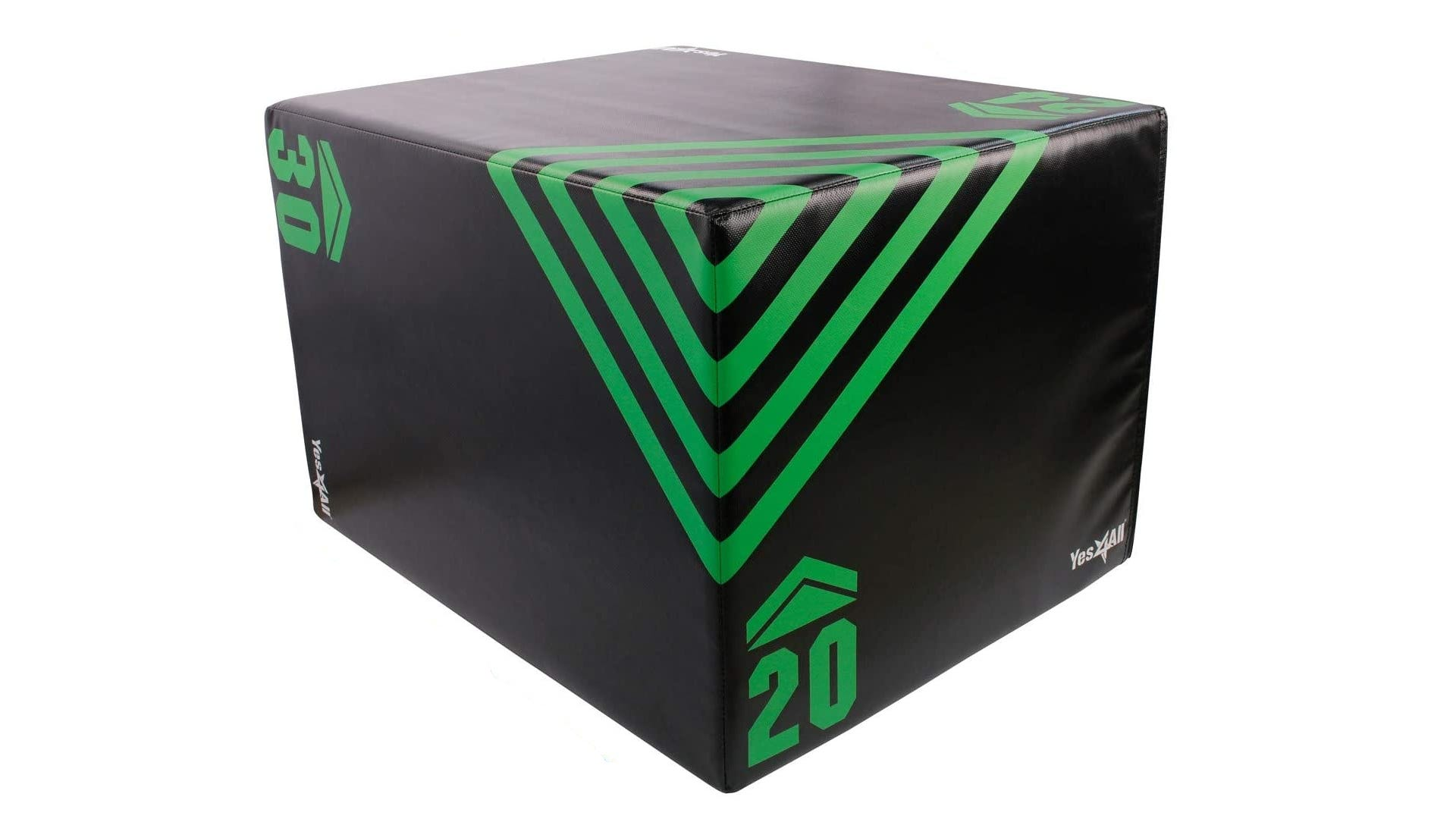 A black plyometric box with a green design and height indicators.