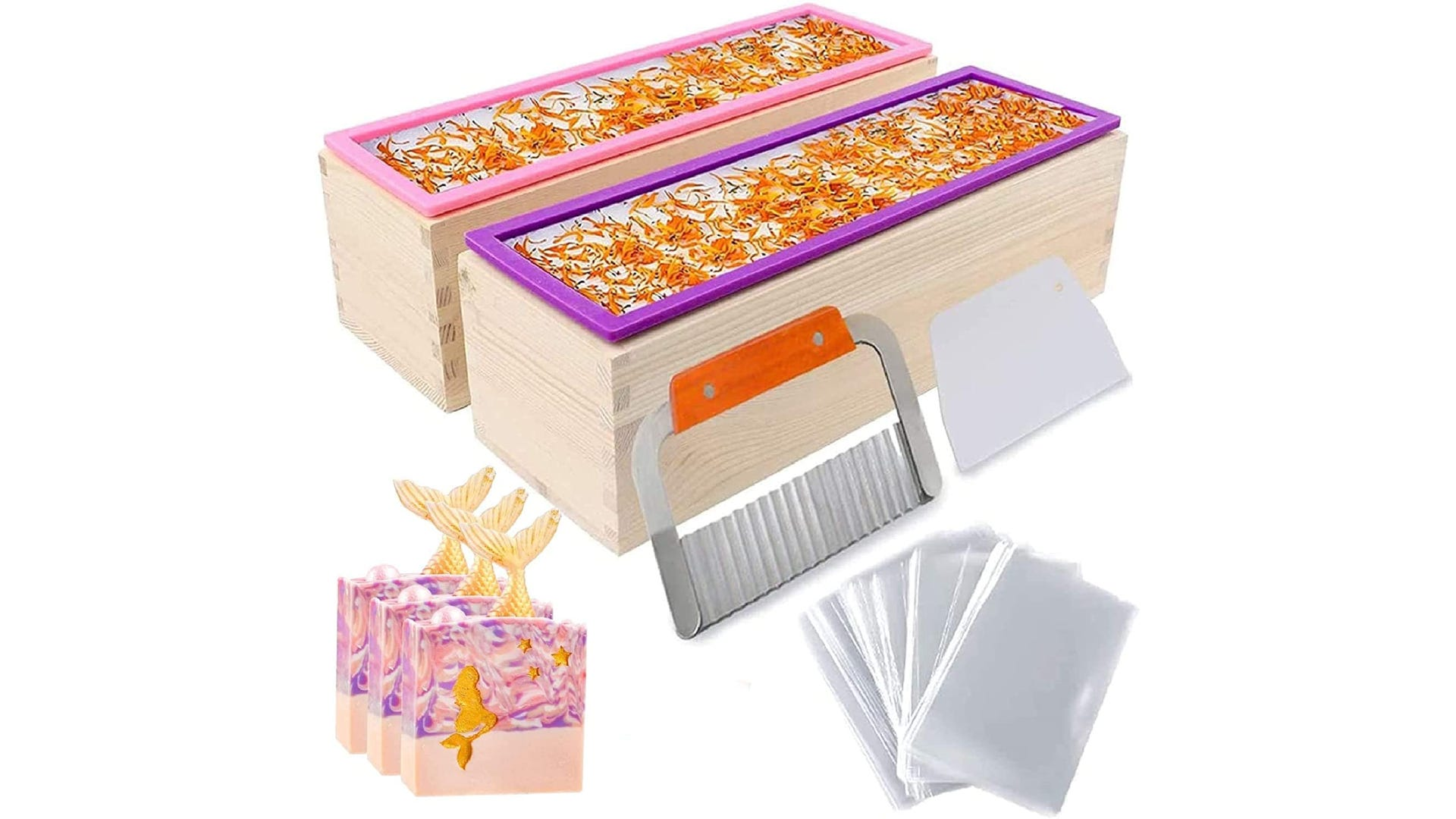 two large rectangular wooden soap molds side by side with several soapmaking accessories