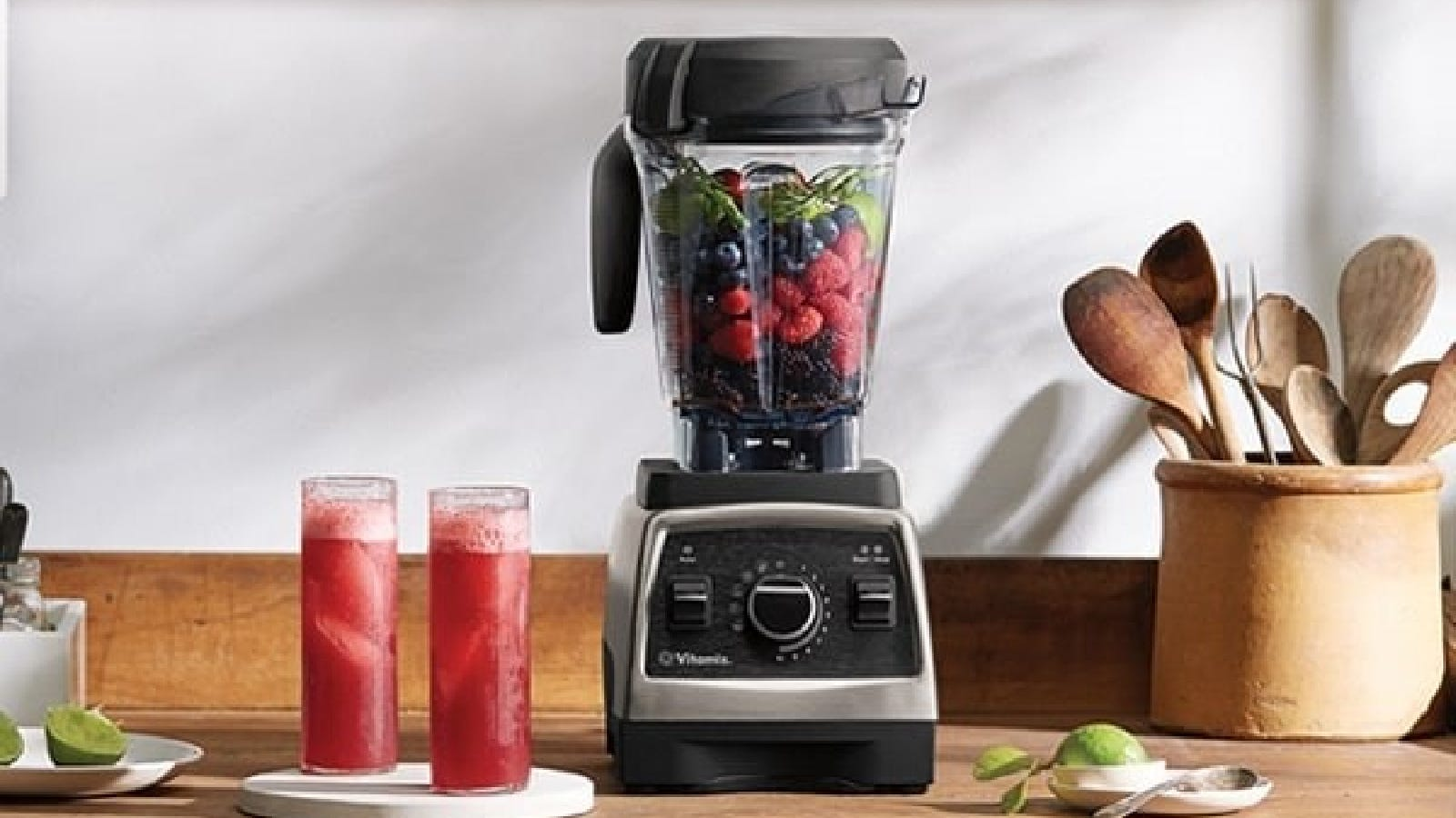 An image of a Vitamix blender filled with fruits, ready to make a smoothie.