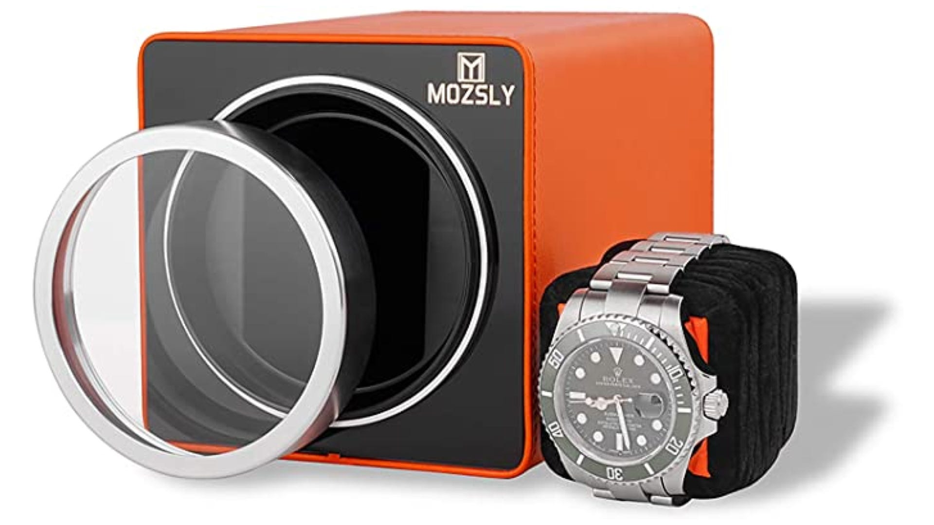 An orange and black watch winder box with glass front removed and pillow displayed.