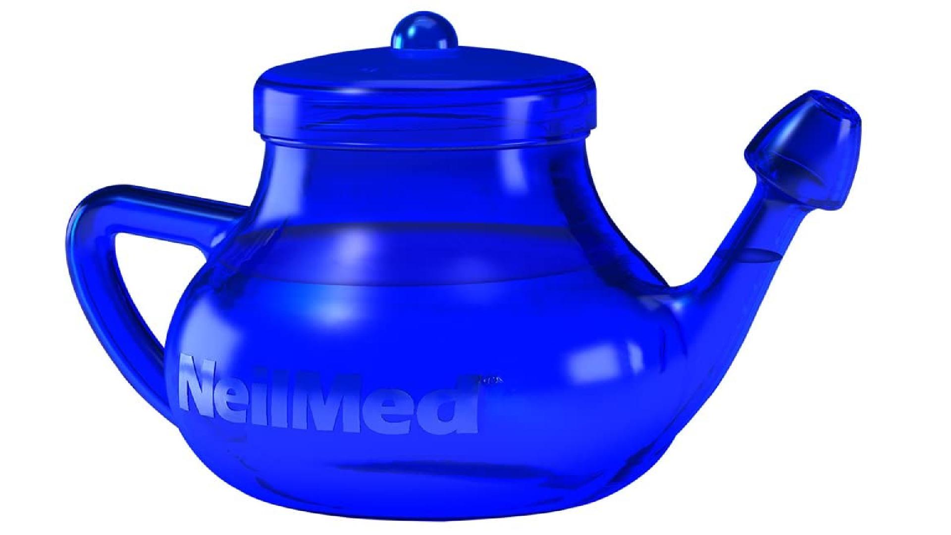 a blue netipot full of water