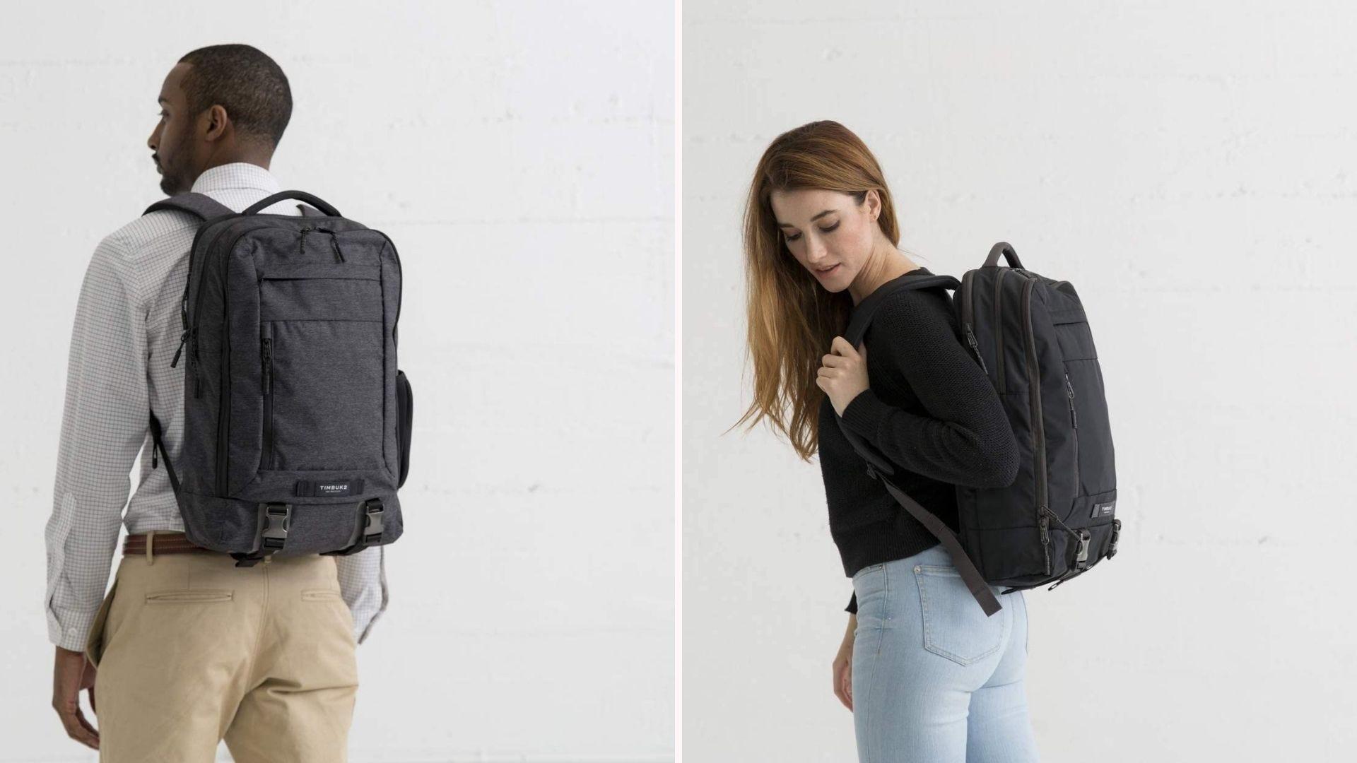 Two people wearing a dark gray/black backpack