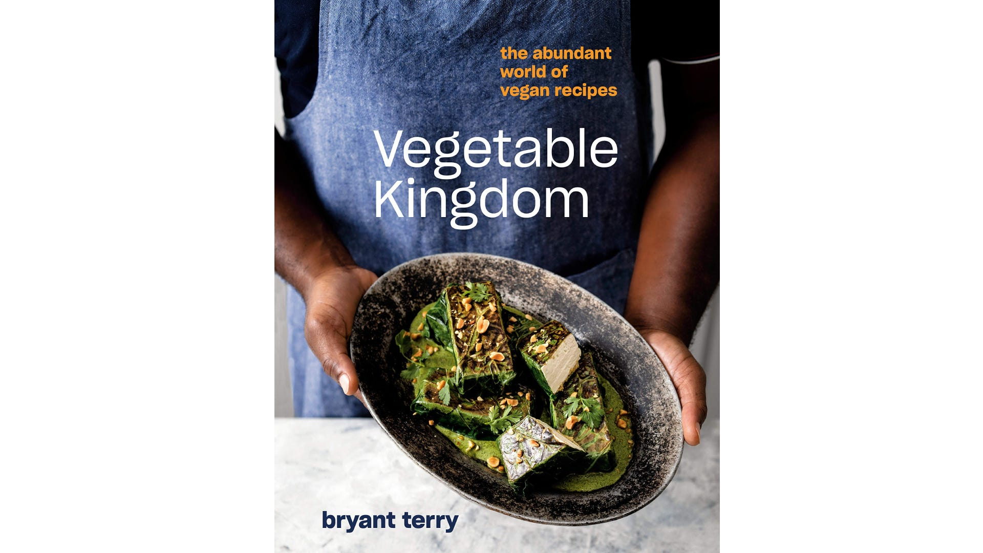 A book cover with a man in a blue apron holding a plate of food.