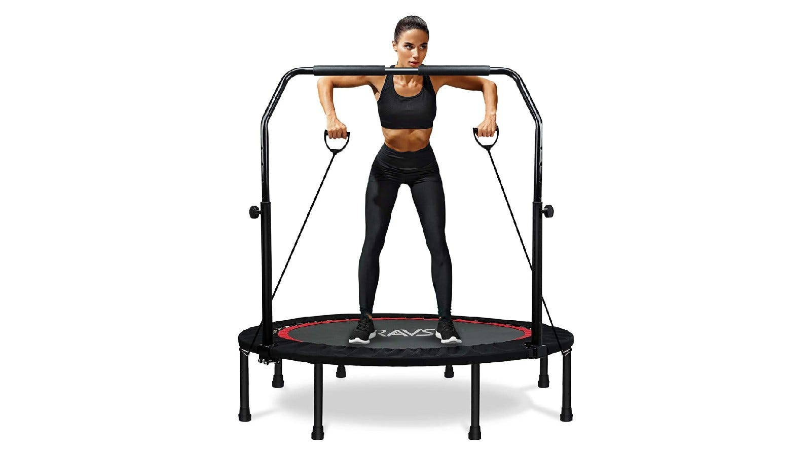 a woman standing on a mini trampoline and using resistance bands