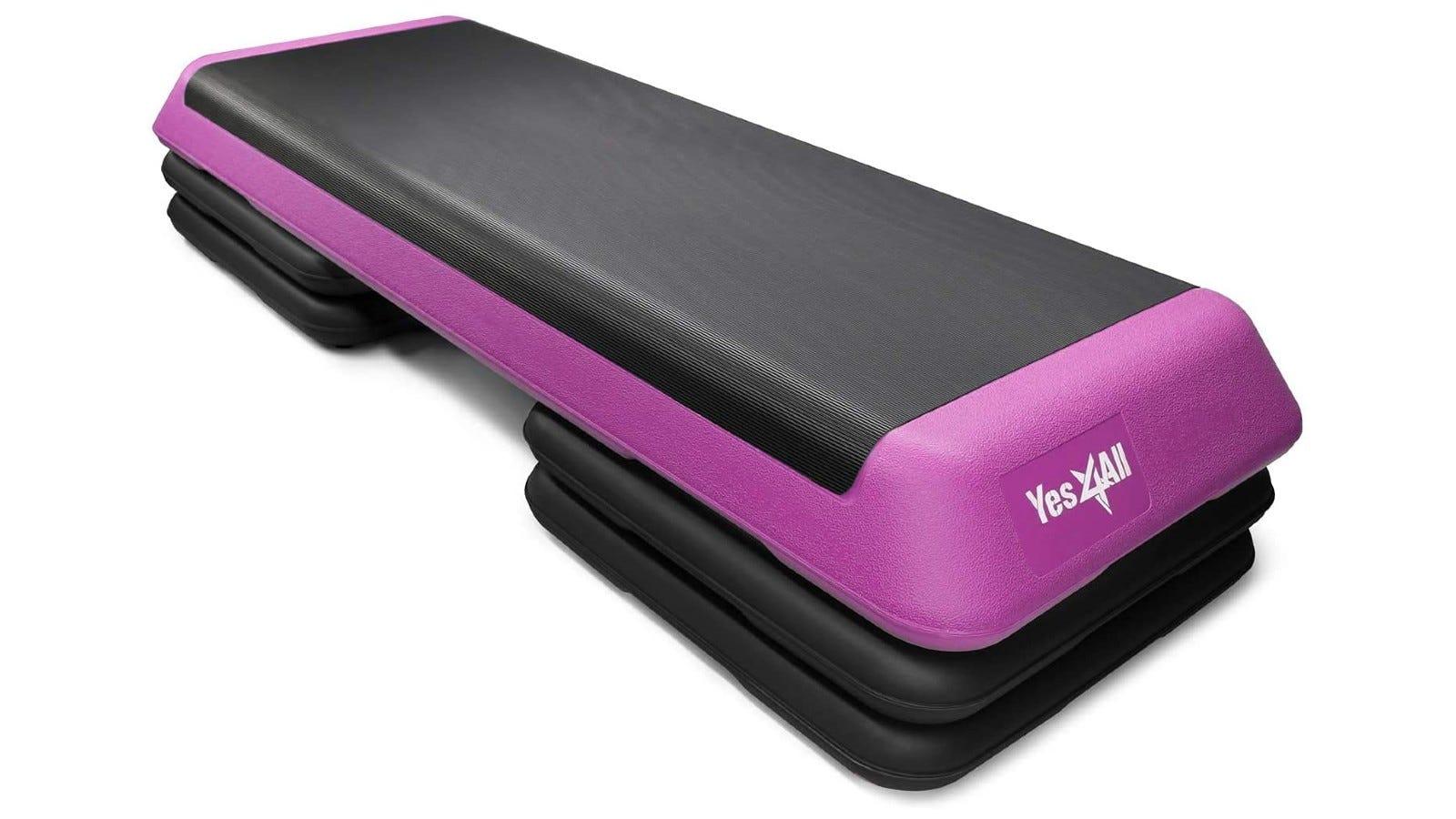 A black step platform with purple detailing.