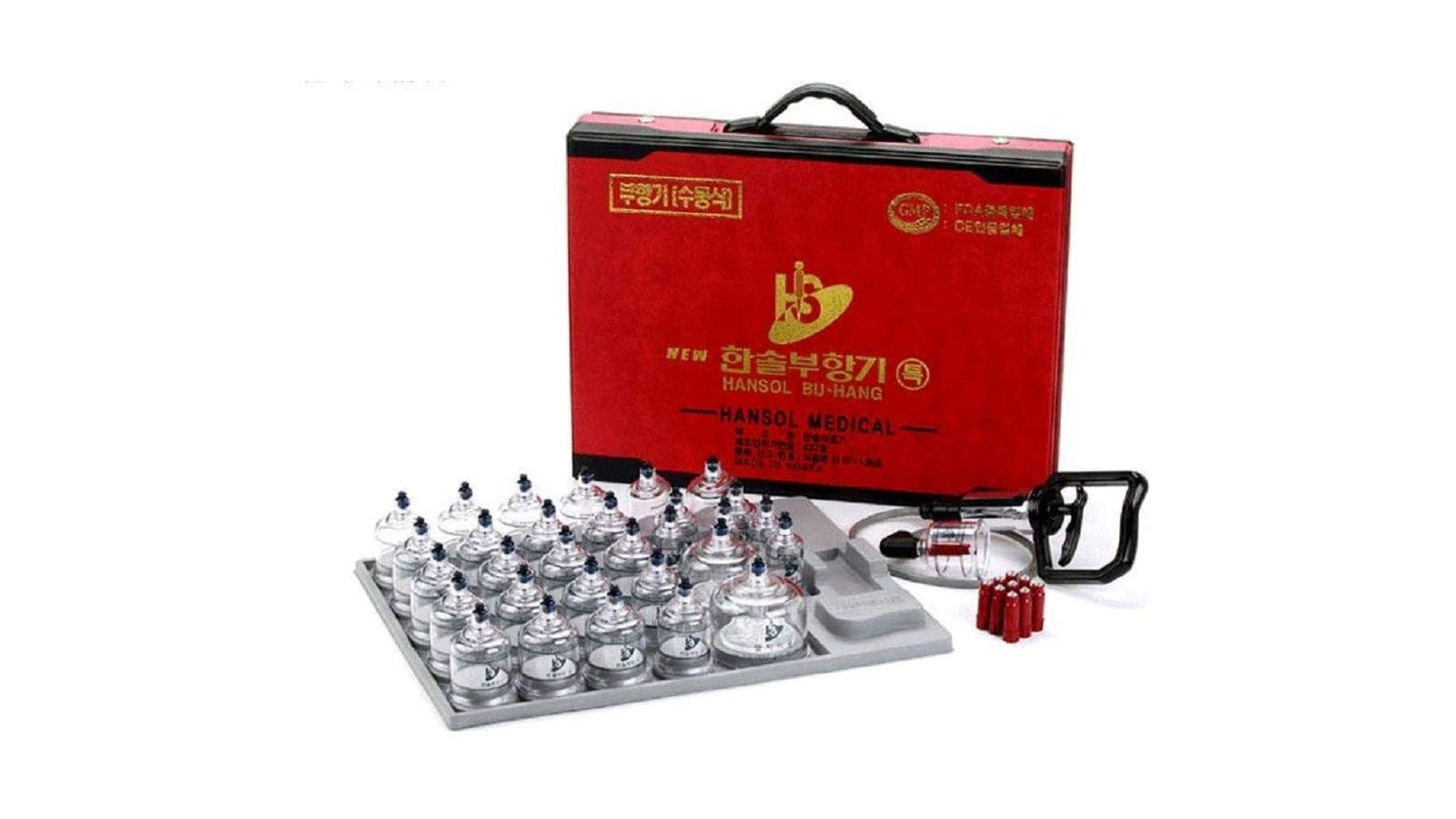 a cupping set with 30 total pieces; cups are lined up by the box and accessories