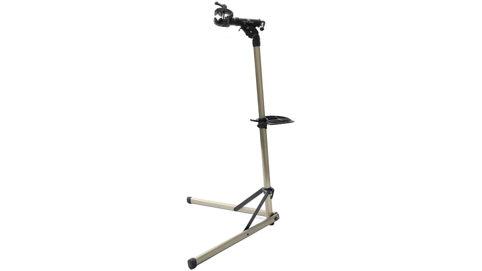A gold bike stand with two supporting legs.