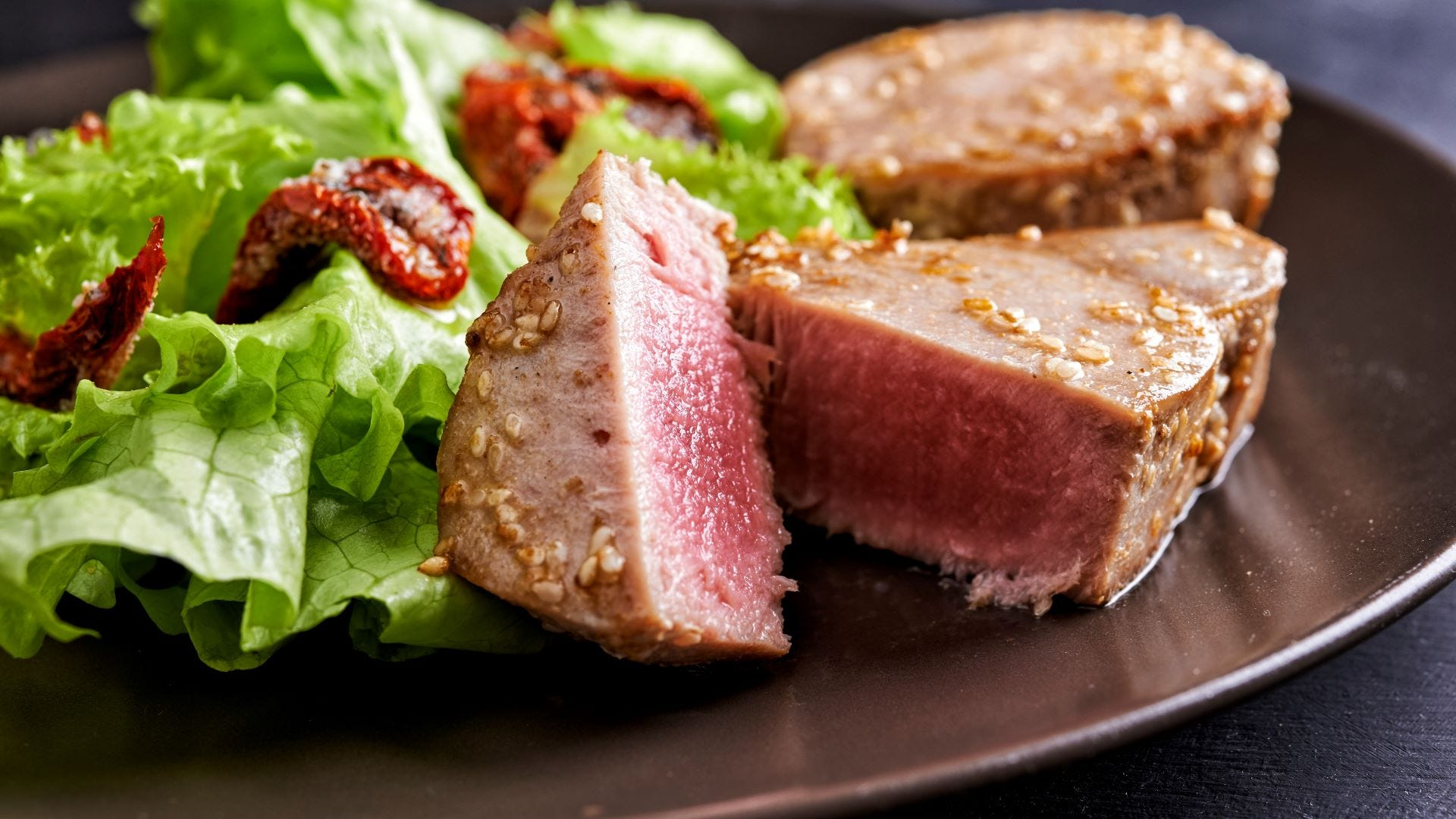 Plate of tuna steak with salad.