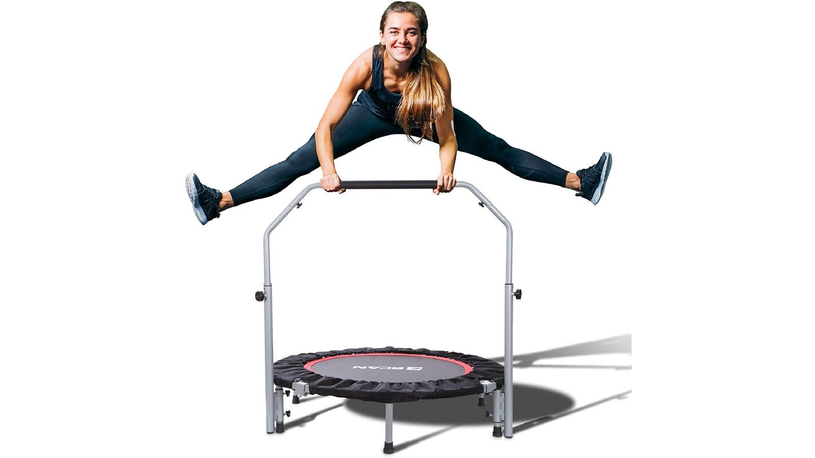 a young woman jumping on a mini trampoline holding a foam handlebar