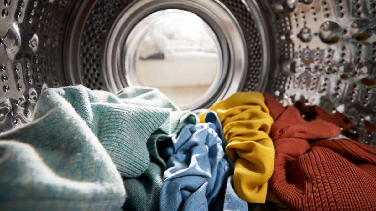 A load of clothes inside a washing machine.