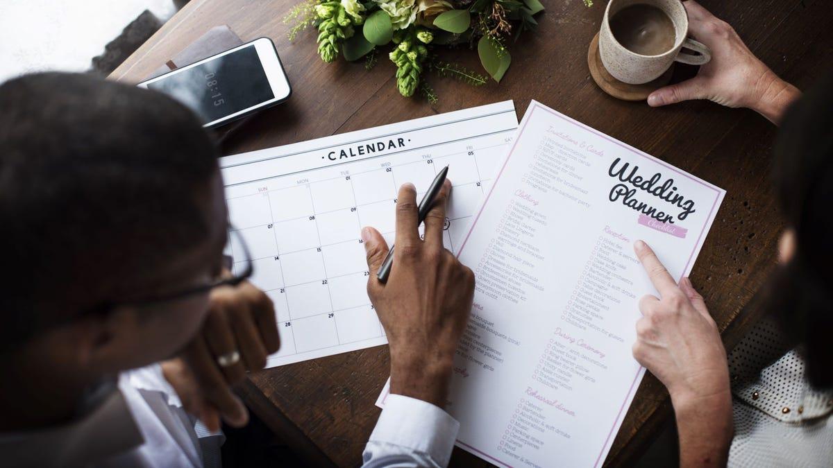 A couple planning a wedding menu.