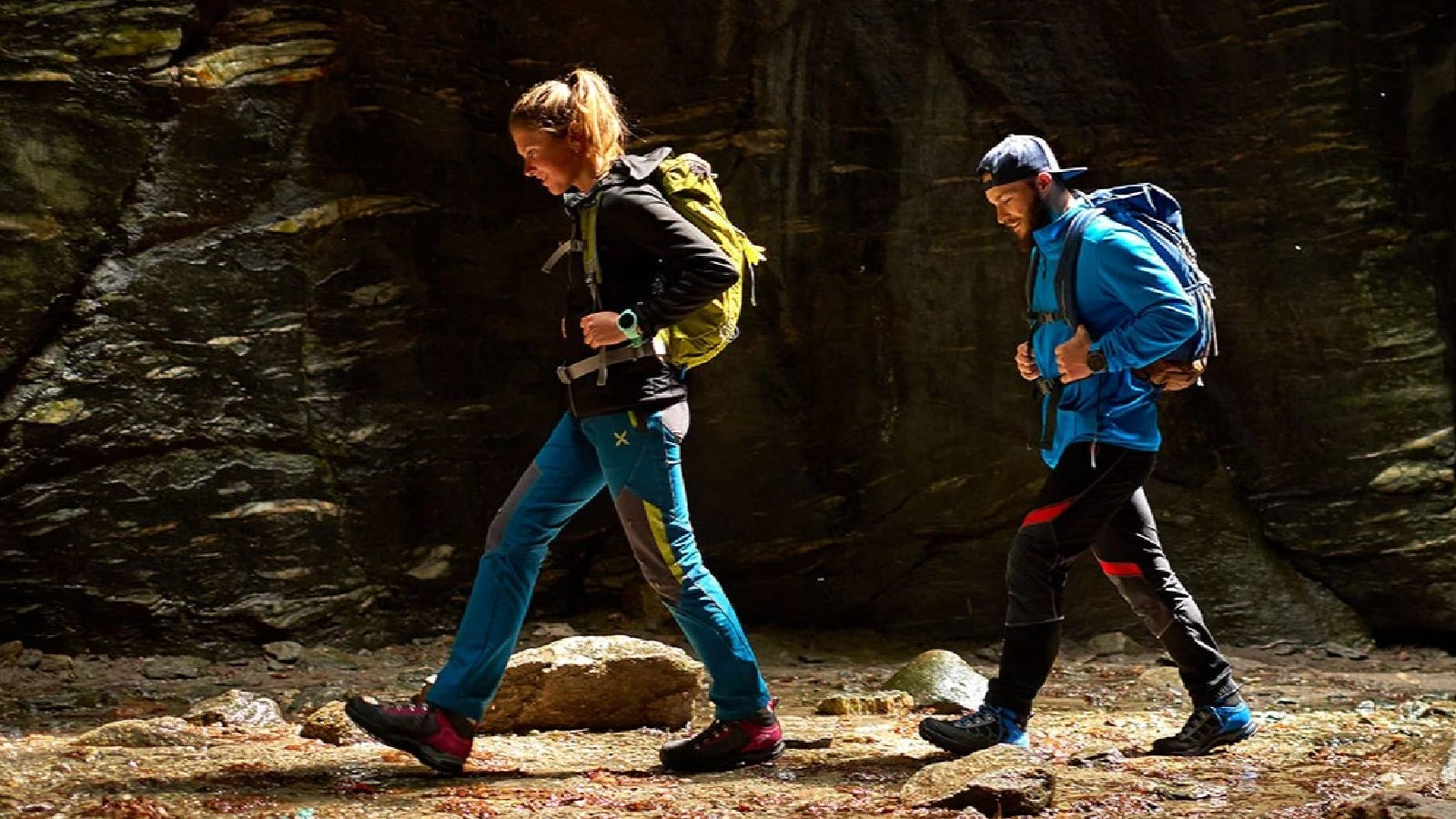 A young couple out hiking while wearing their durable Asolo backpacking boots.