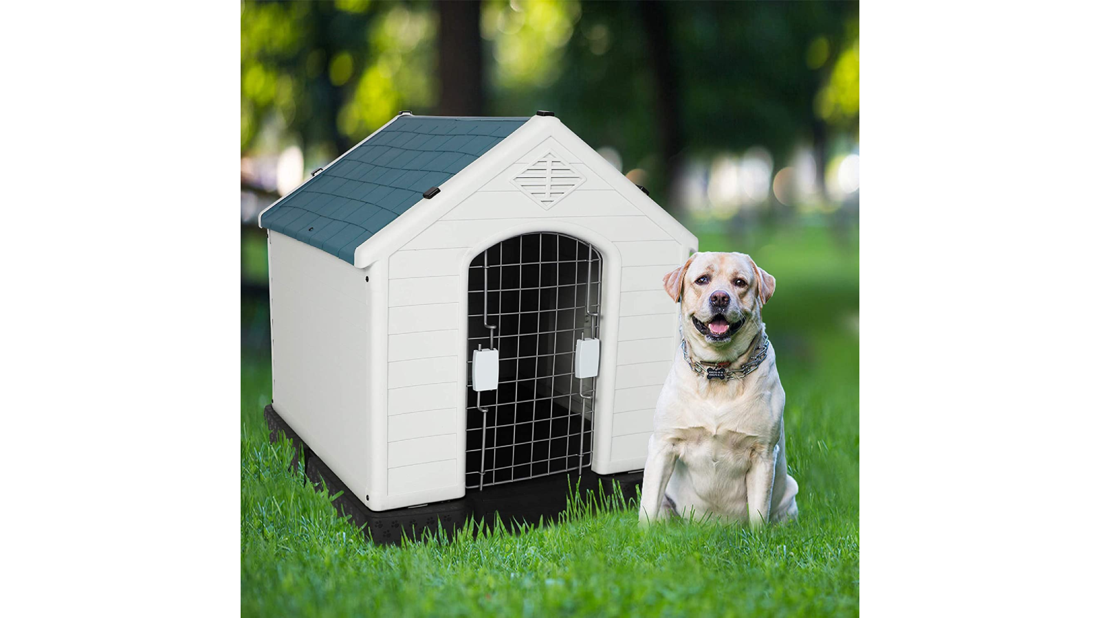 White plastic doghouse with wire door and white dog sitting outside.