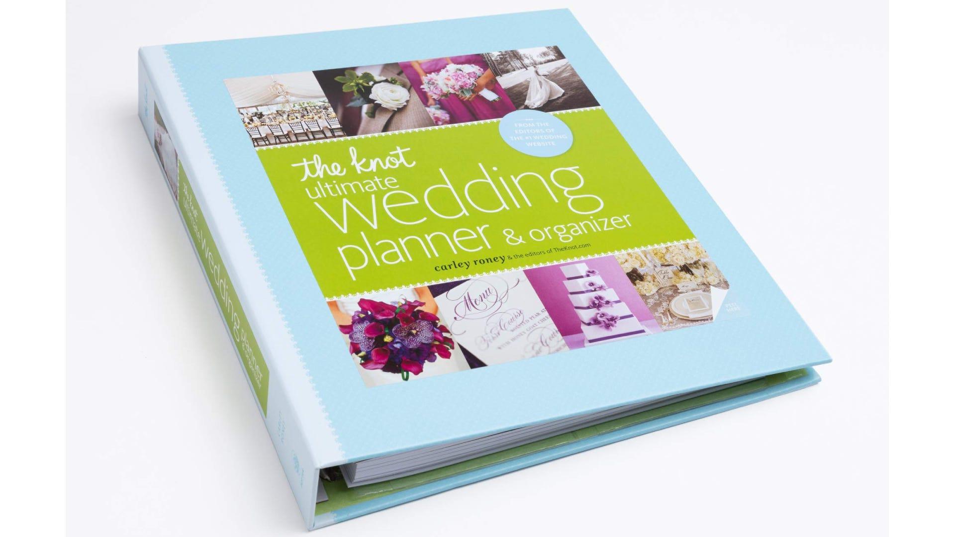 A blue and green binder wedding planner book.
