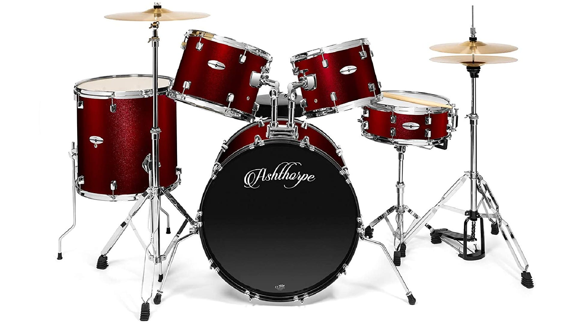 front-side view of red-colored drum set with bass drum, snare drum, two mounted toms, floor tom, hi-hat, and crash.