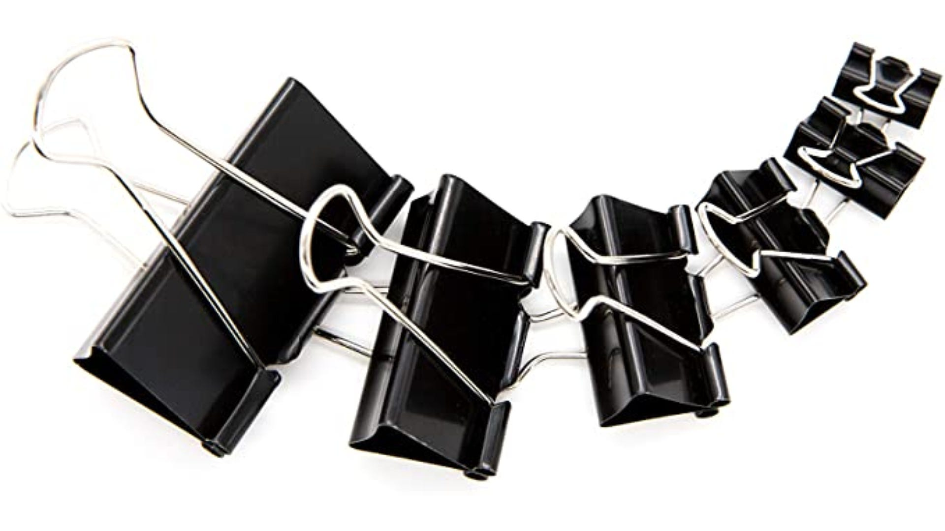 six multi sized black binder clips displayed in line