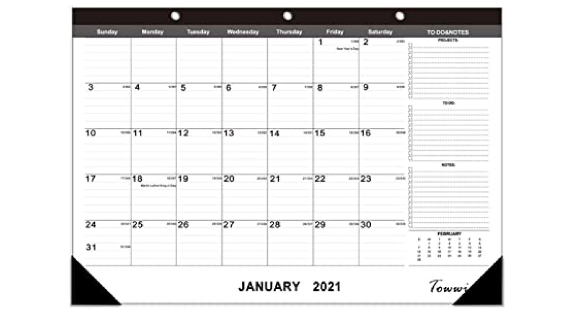 large monthly desk planner with black top and corners and additional note space
