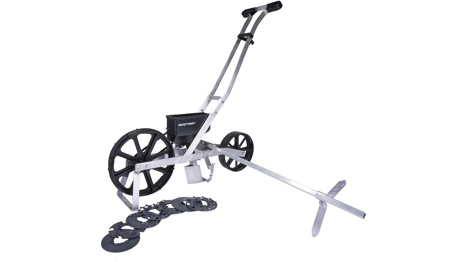 Push seed spreader with 7 seed plates displayed on ground