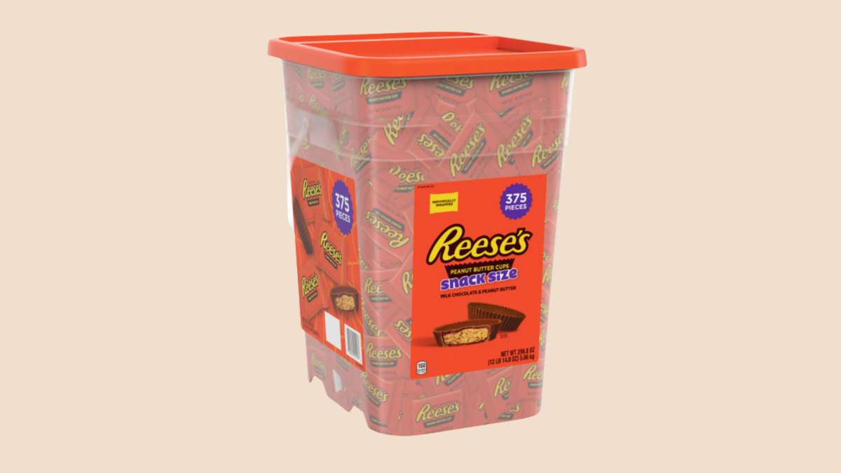 A plastic bin full of 375 individually wrapped Reese's Cups.
