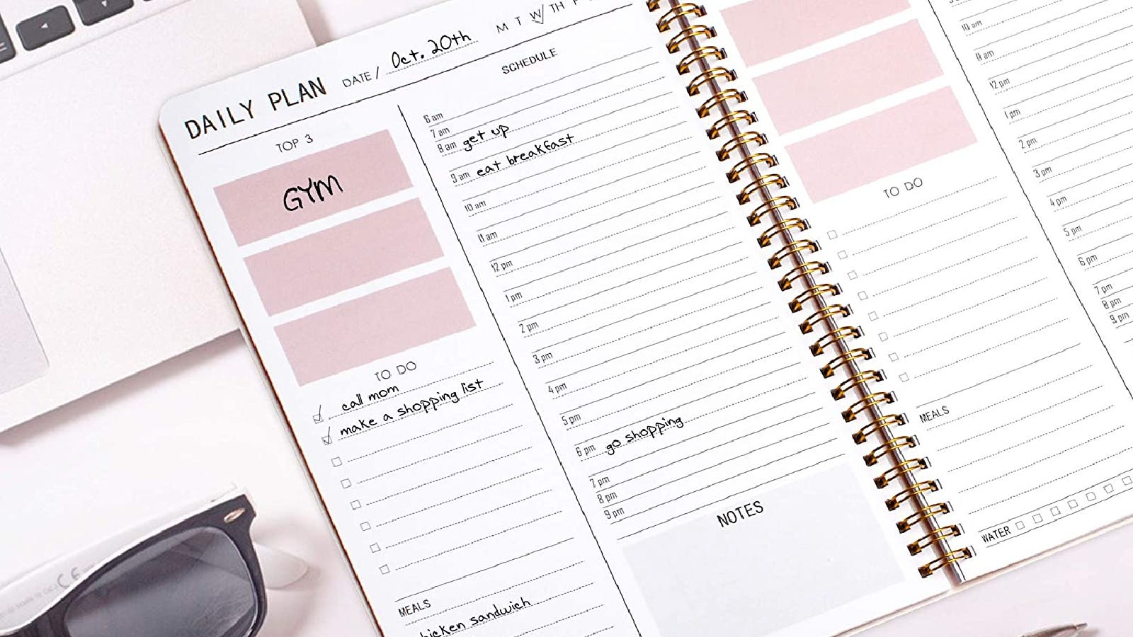 a planner on a desk open to show daily plans