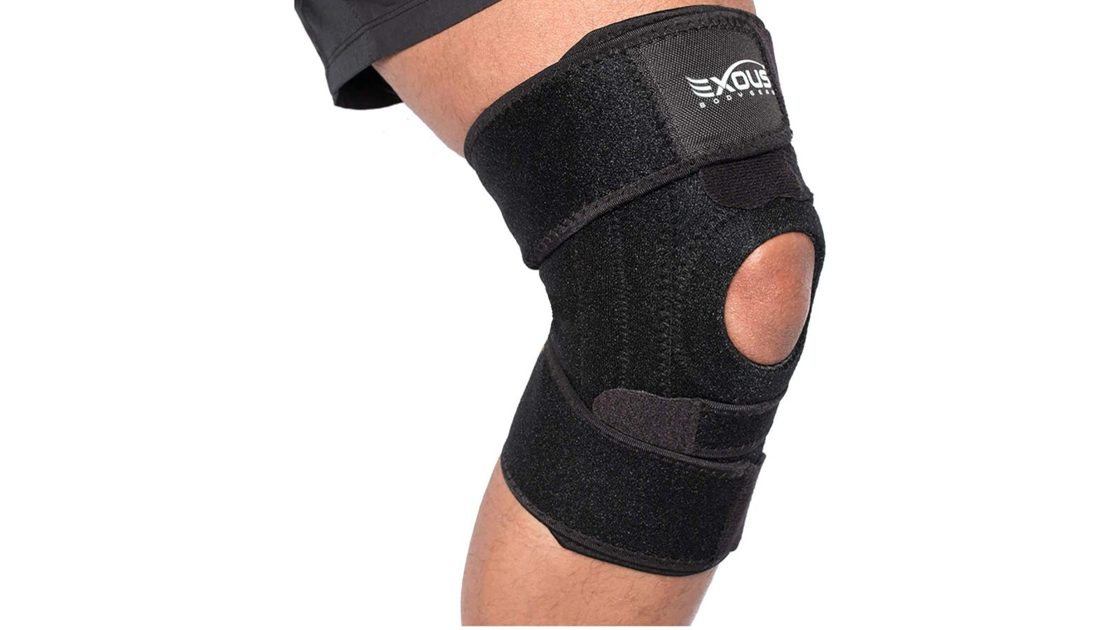 A person wearing a black open patella knee brace with 4 adjustable anchor points.