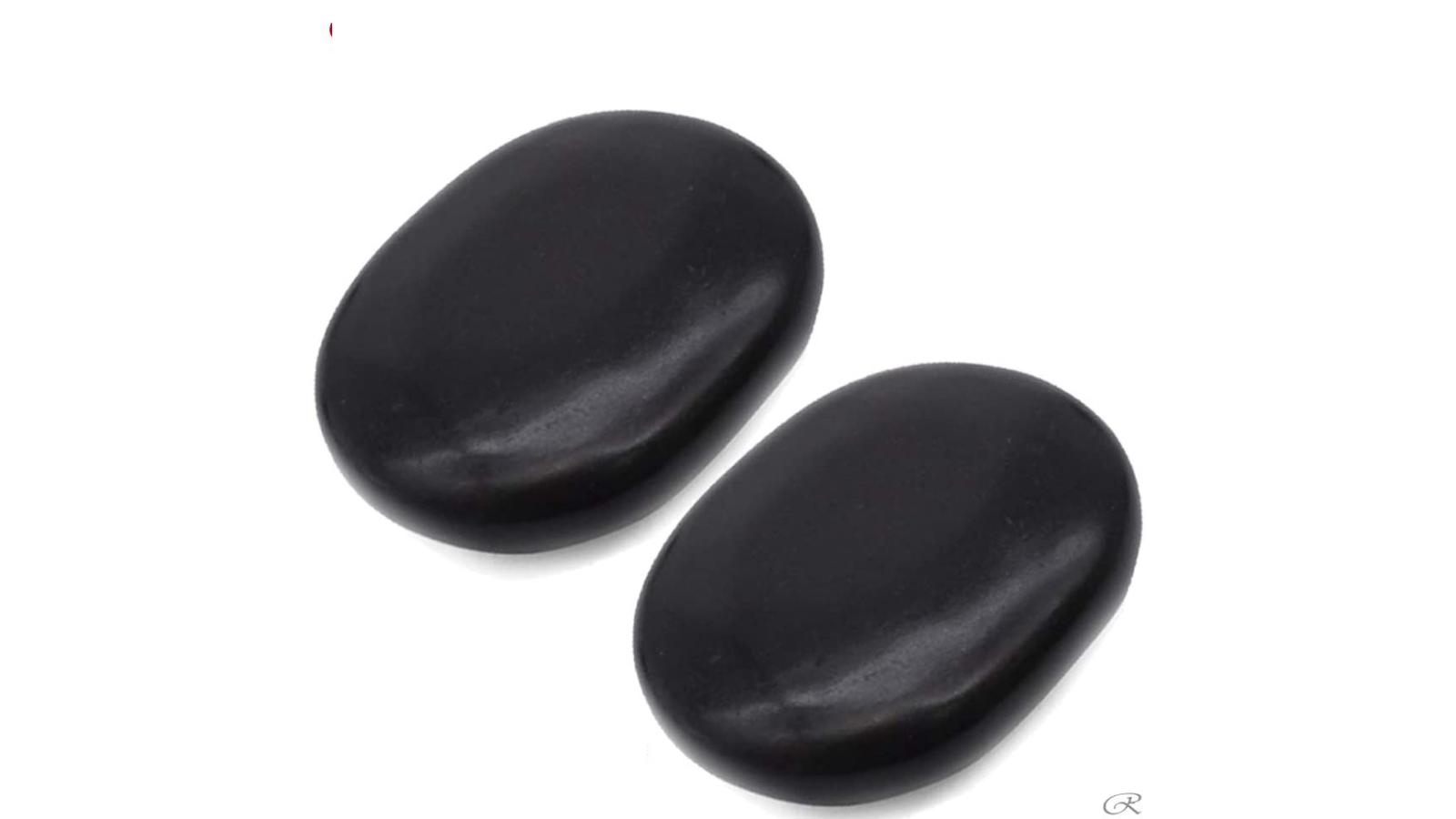 Two large, black massage stones