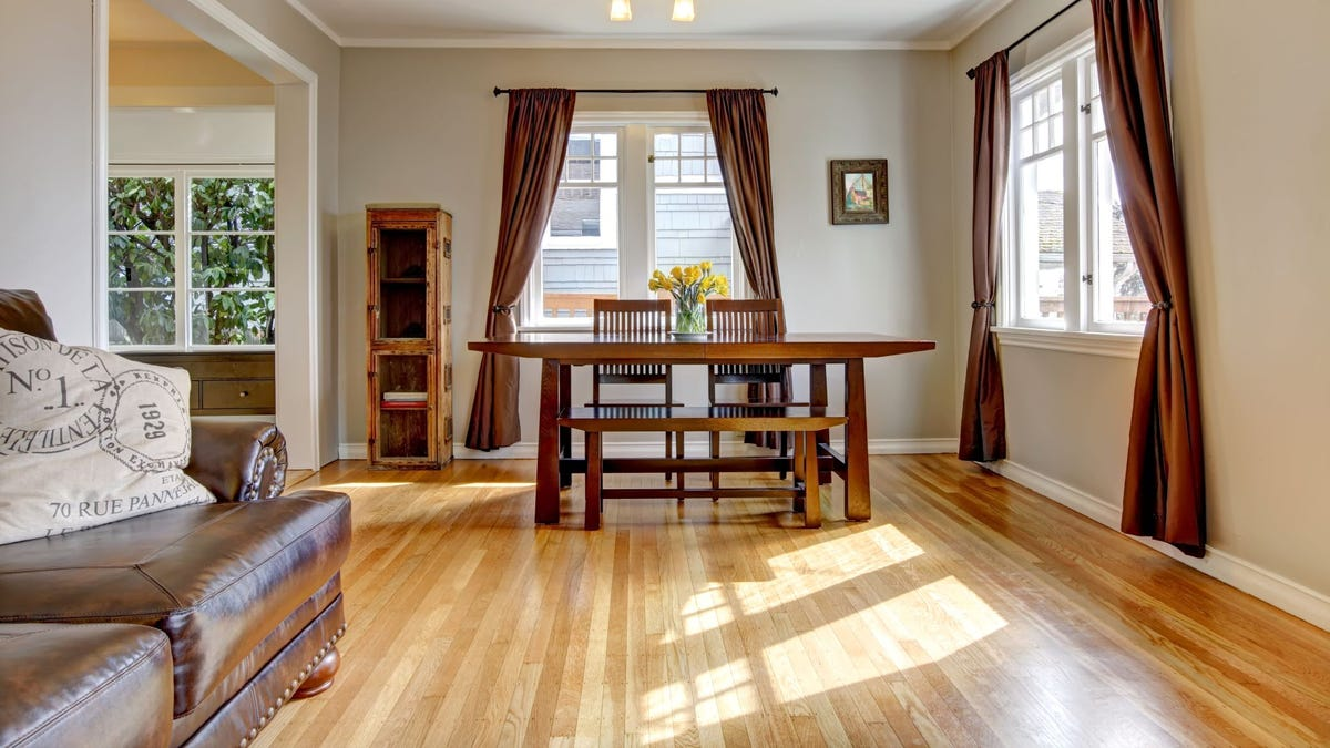 A living/dining room with hardwood flooring.