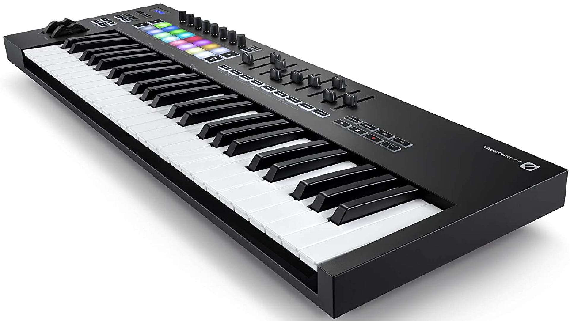 A large MIDI keyboard with 49 piano keys, 16 pads, and multiple knobs, sliders, and buttons.