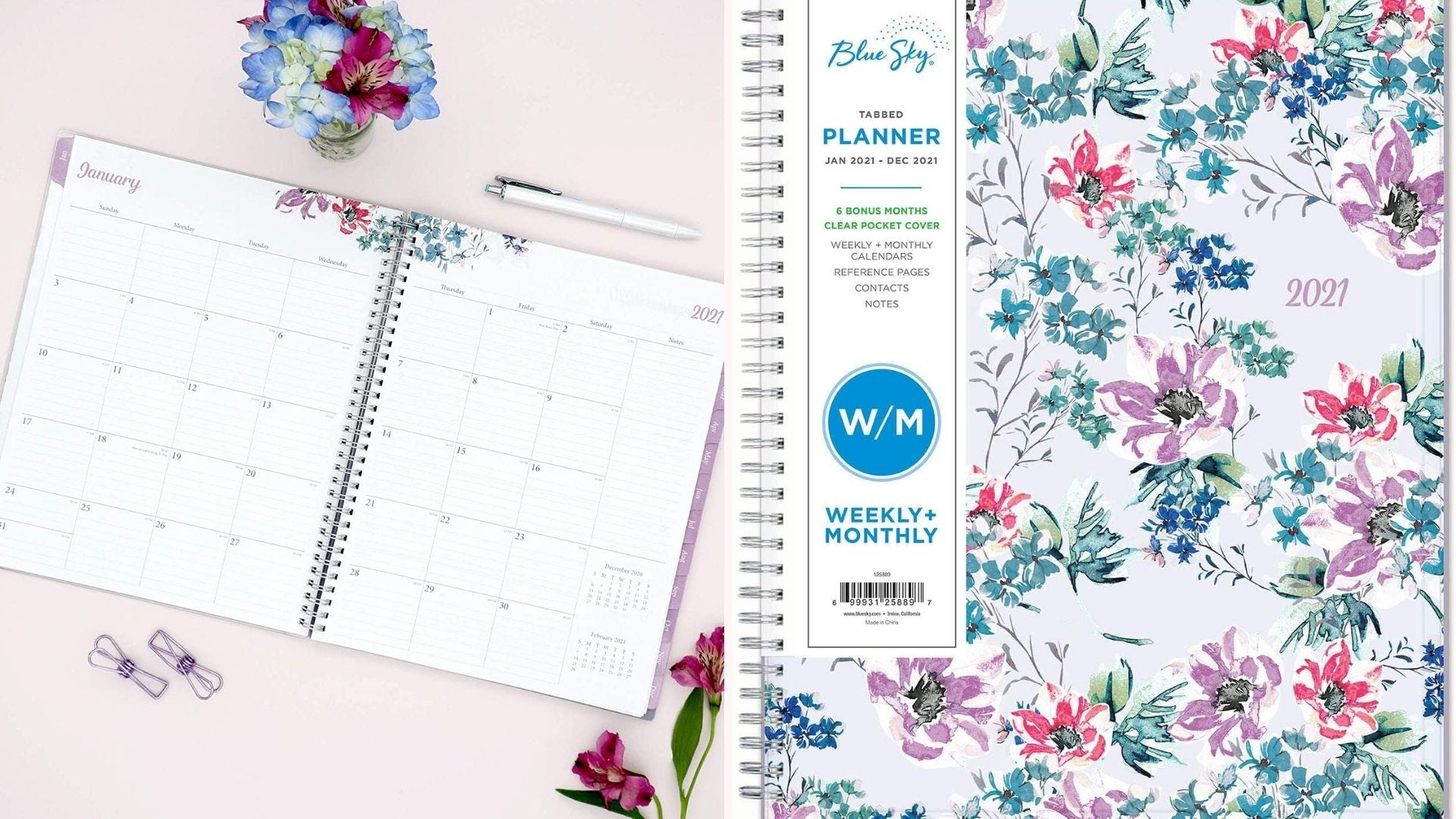 opened floral-printed planner on desk with flowers and pen