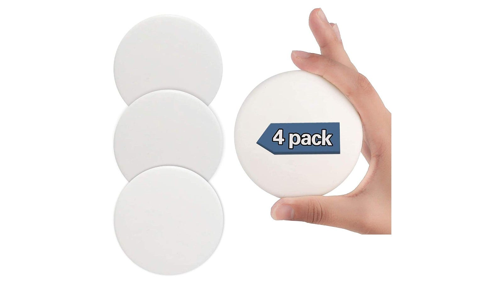 four white round silicone door stoppers that mount to the wall