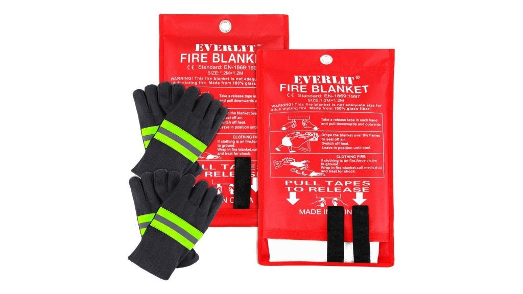 two fire blankets in red packaging next to two pairs of black gloves