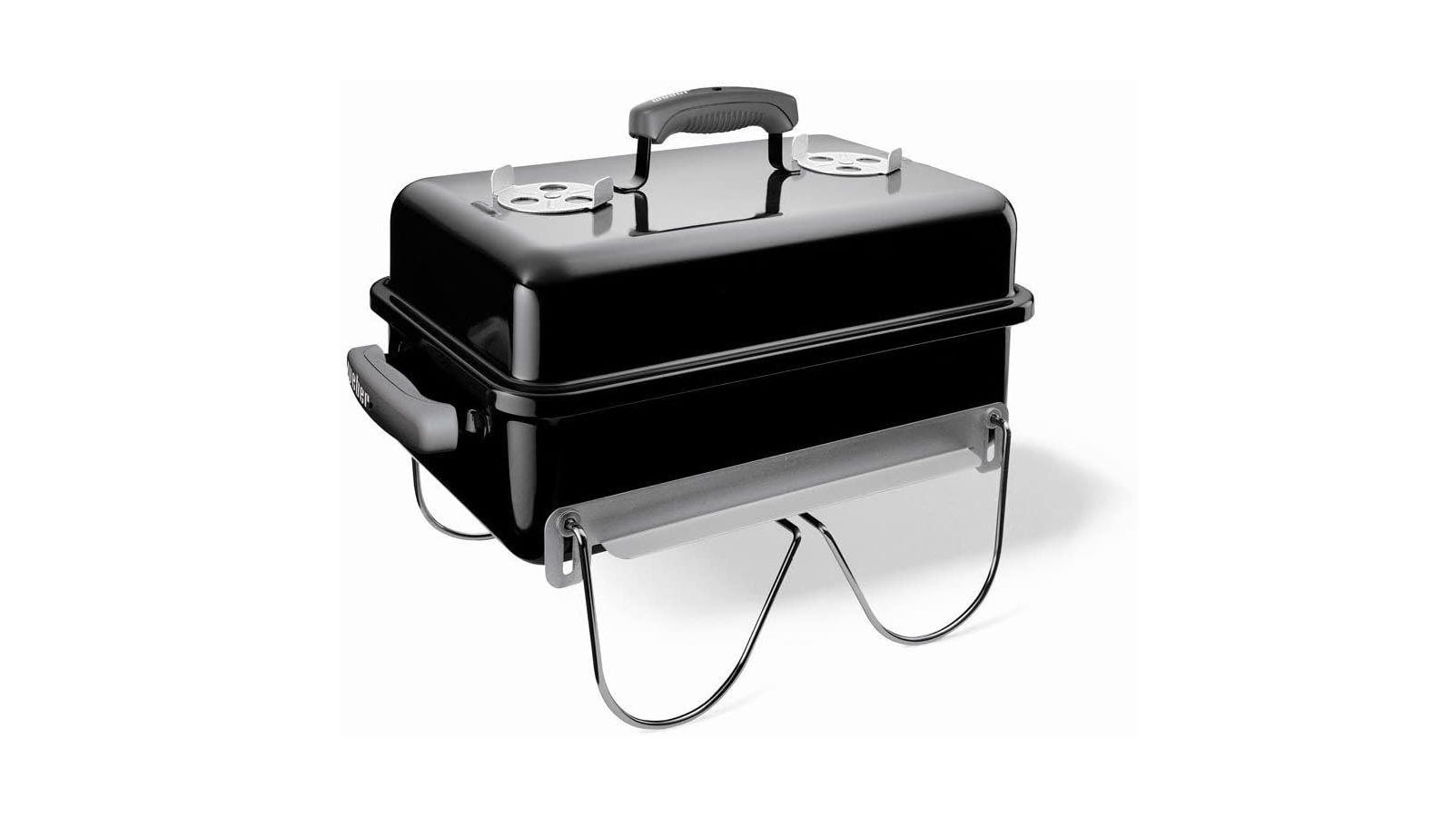 Black Weber ultra-portable charcoal grill with porcelain-enameled lid and base