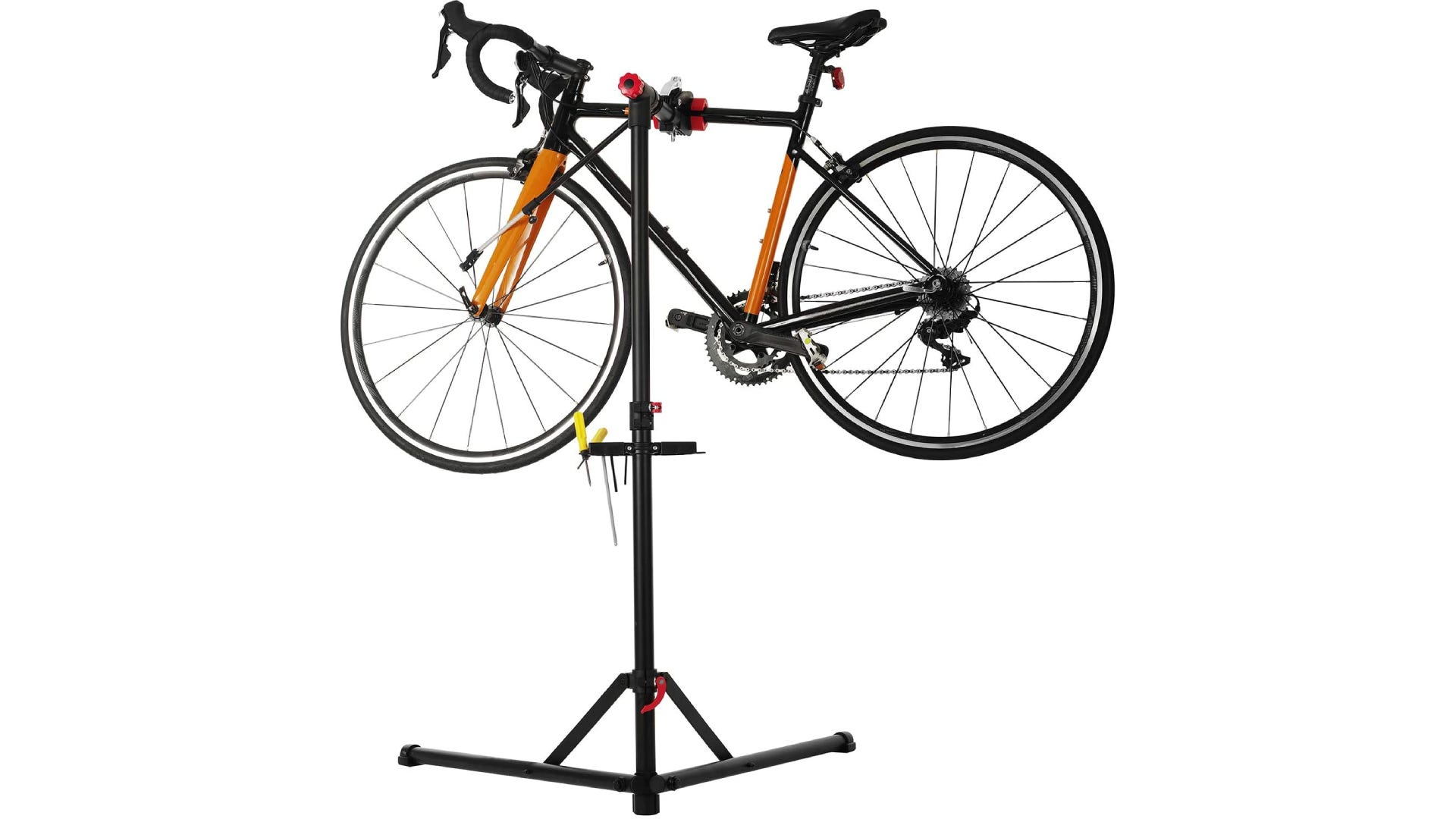 A orange and black bike clamped into a black bike stand.