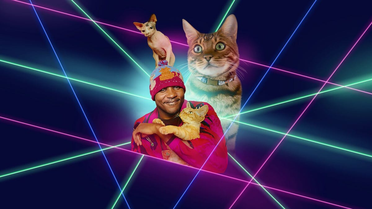 A man holds a cat while two are superimposed behind him against '80s style lasers.