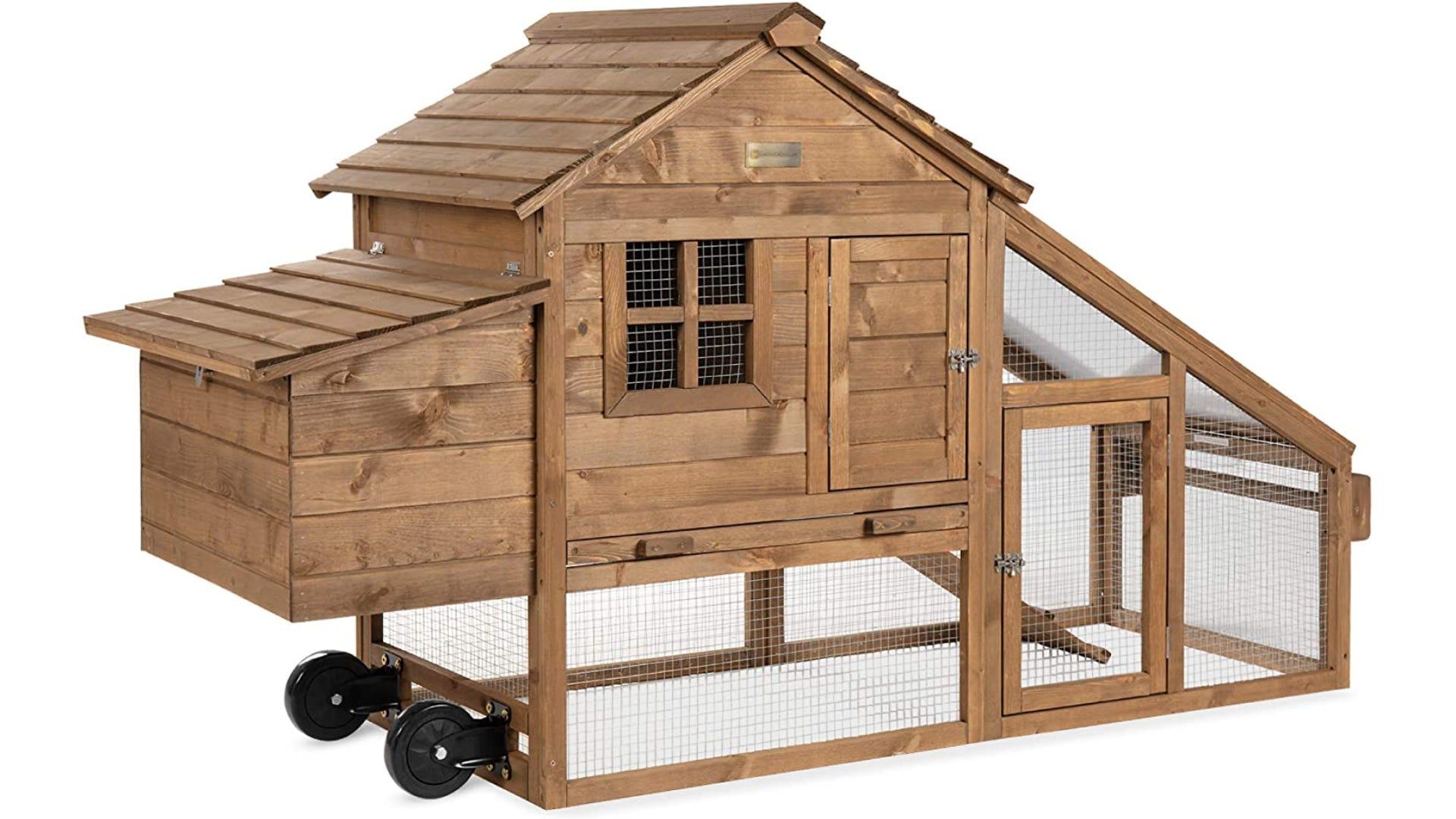 Wooden chicken coop with built-in wheels.
