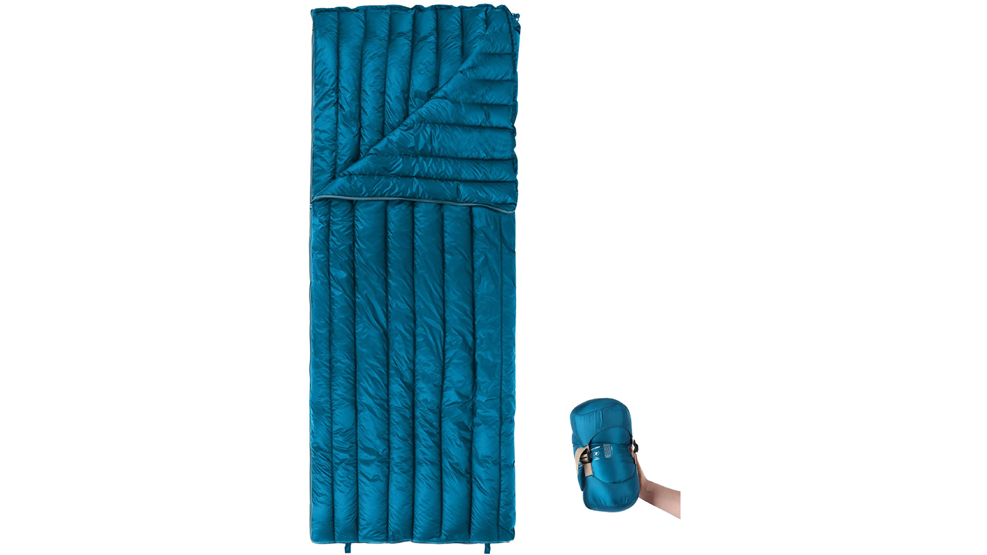 a sleeping bag with a hand holding it rolled up
