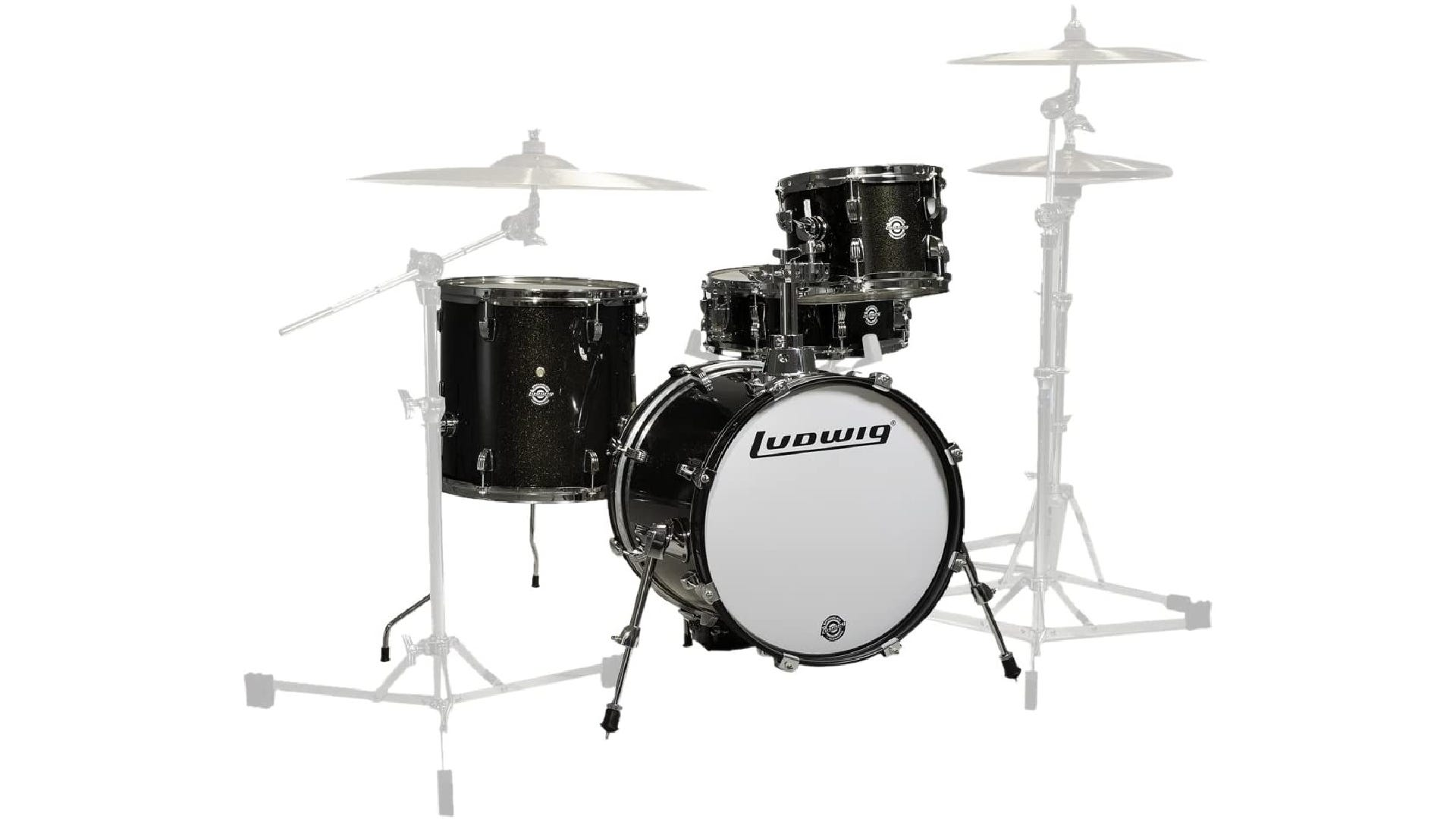 dark-colored drum set with bass drum, snare, tom, and floor tom.