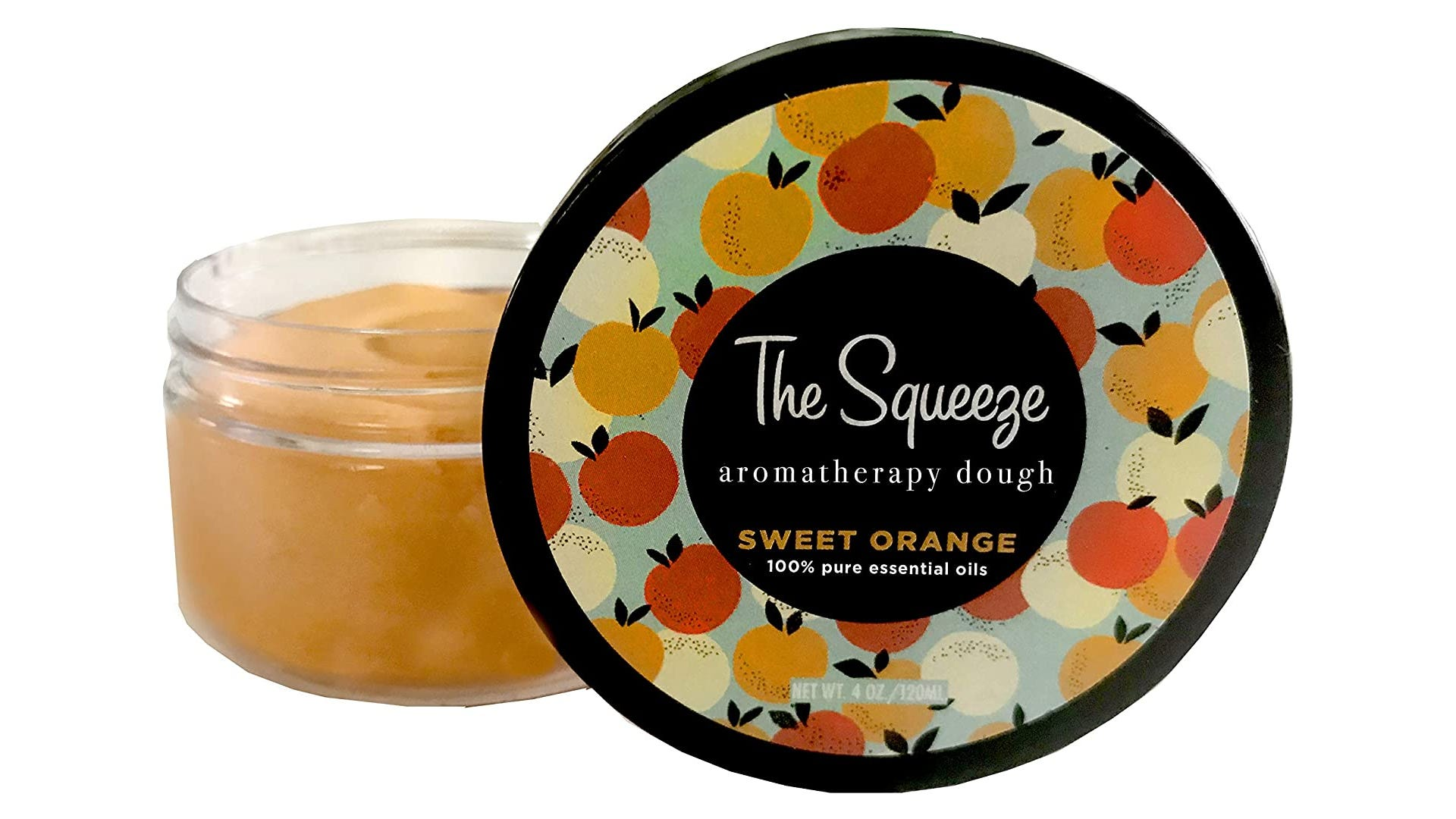 A jar of orange colored putty sits open with the lid displayed before it.