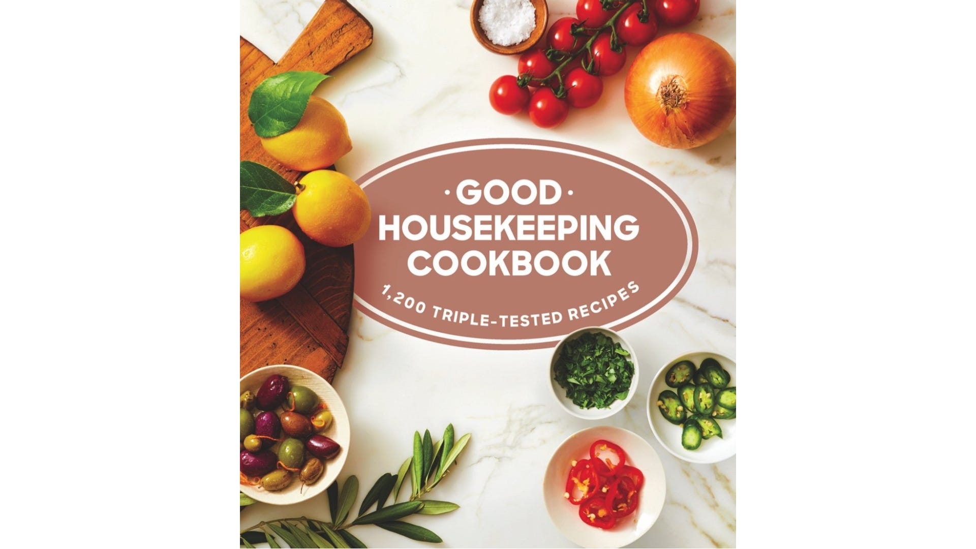 A book cover with several bowls of ingredients and a wooden cutting board.