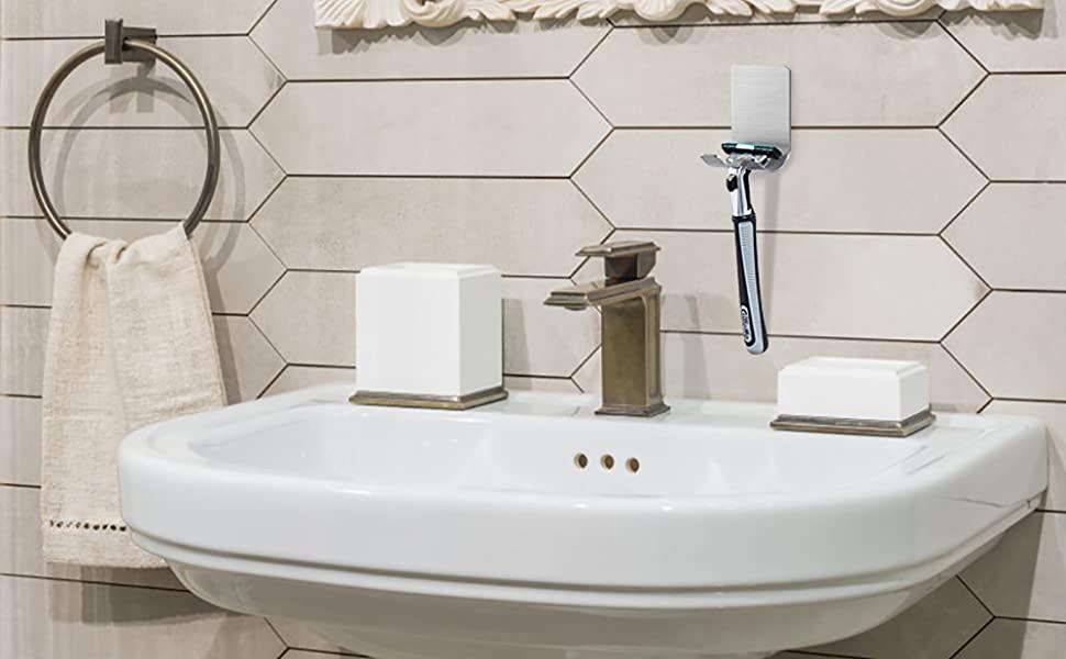 A razor holder next to a sink.