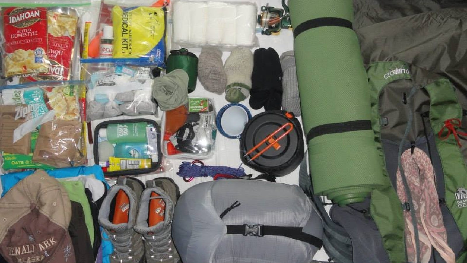 Various gear laid out on the bed before a seven day backpacking trip on the Appalachian trail.