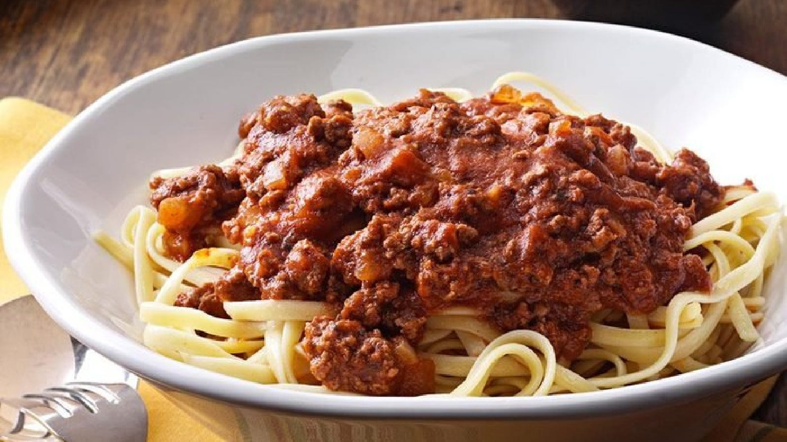 a plate of spaghetti toppe with homemade sauce.