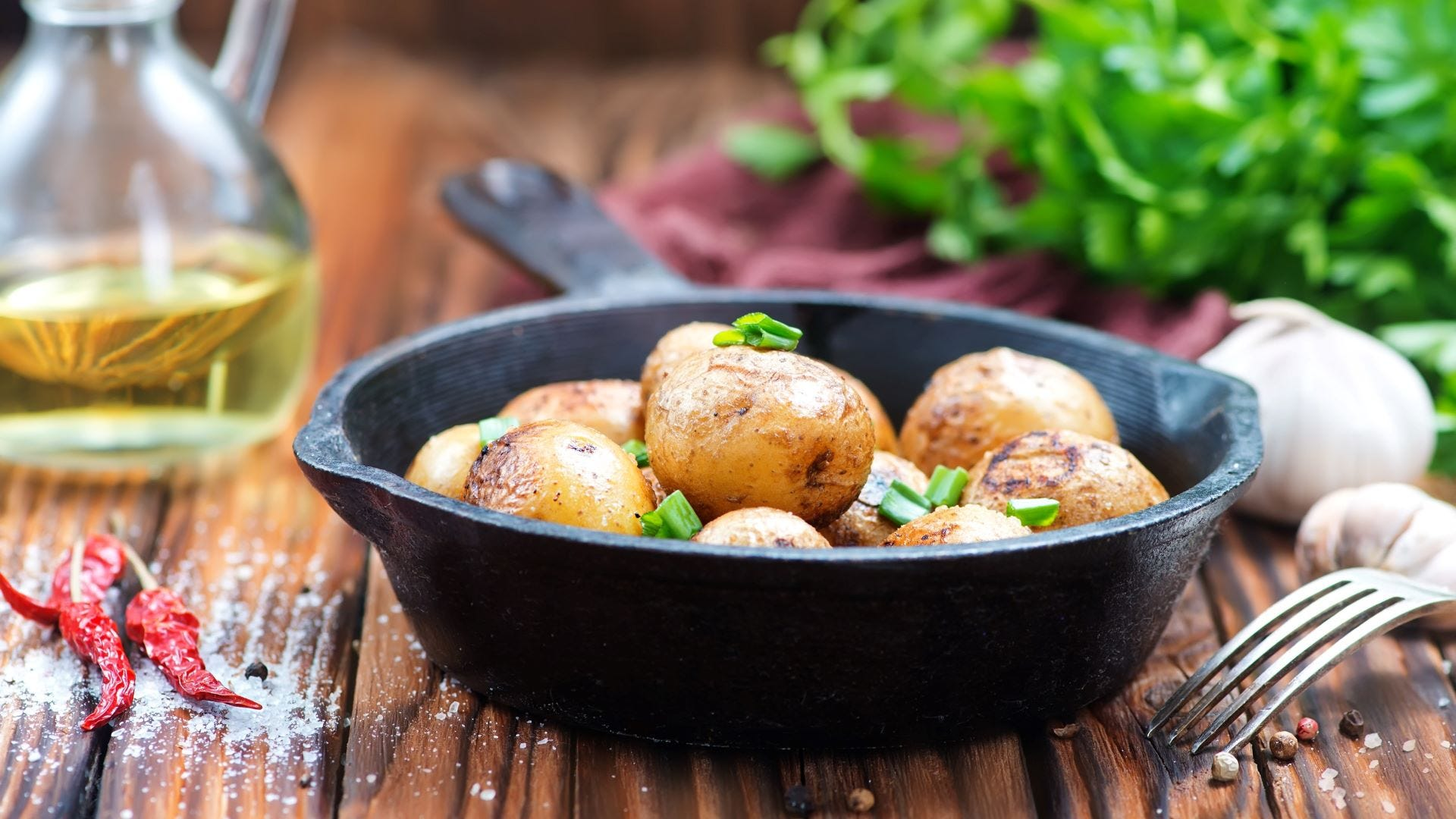 Potatoes in a cast-iron skillet.