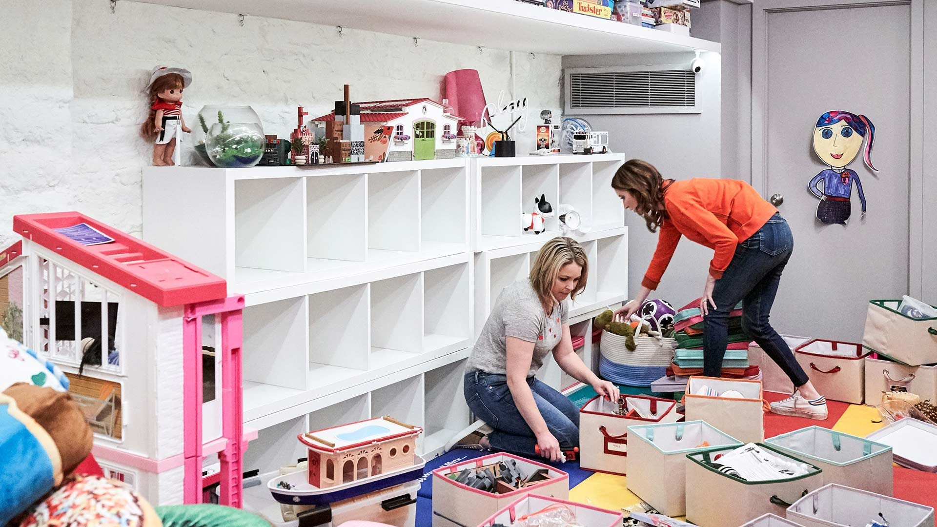 The Home Edit team cleaning up a room before organizing it.