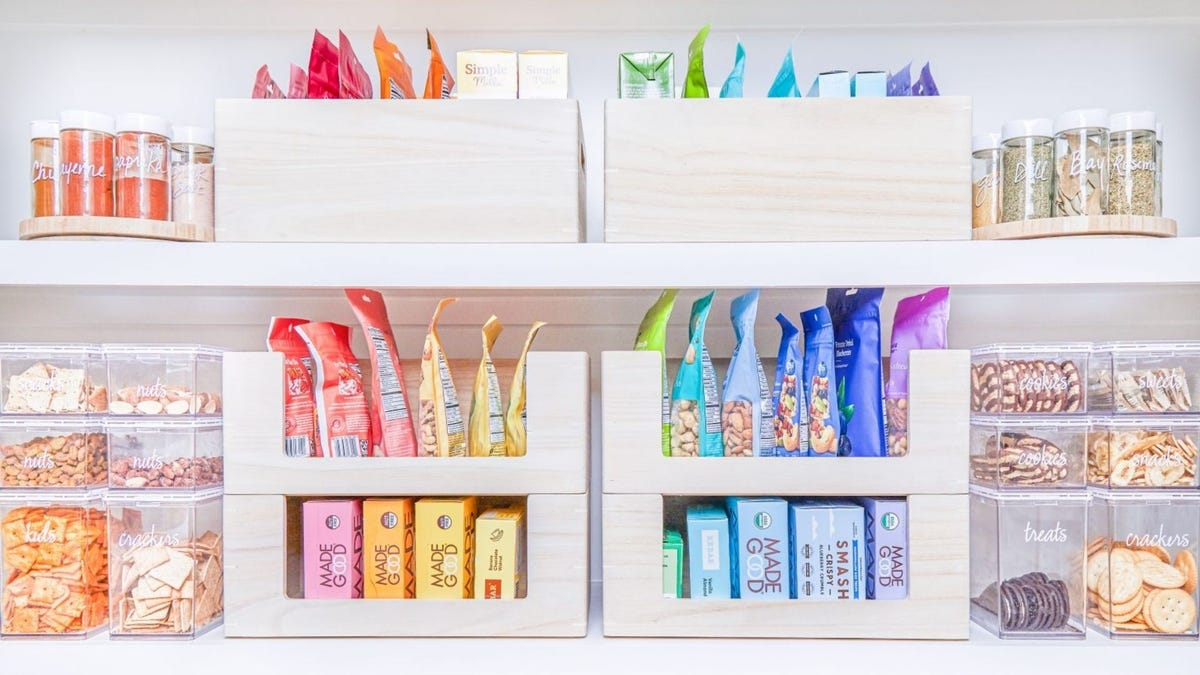 Neatly organized pantry goods on a shelf, arranged by color.