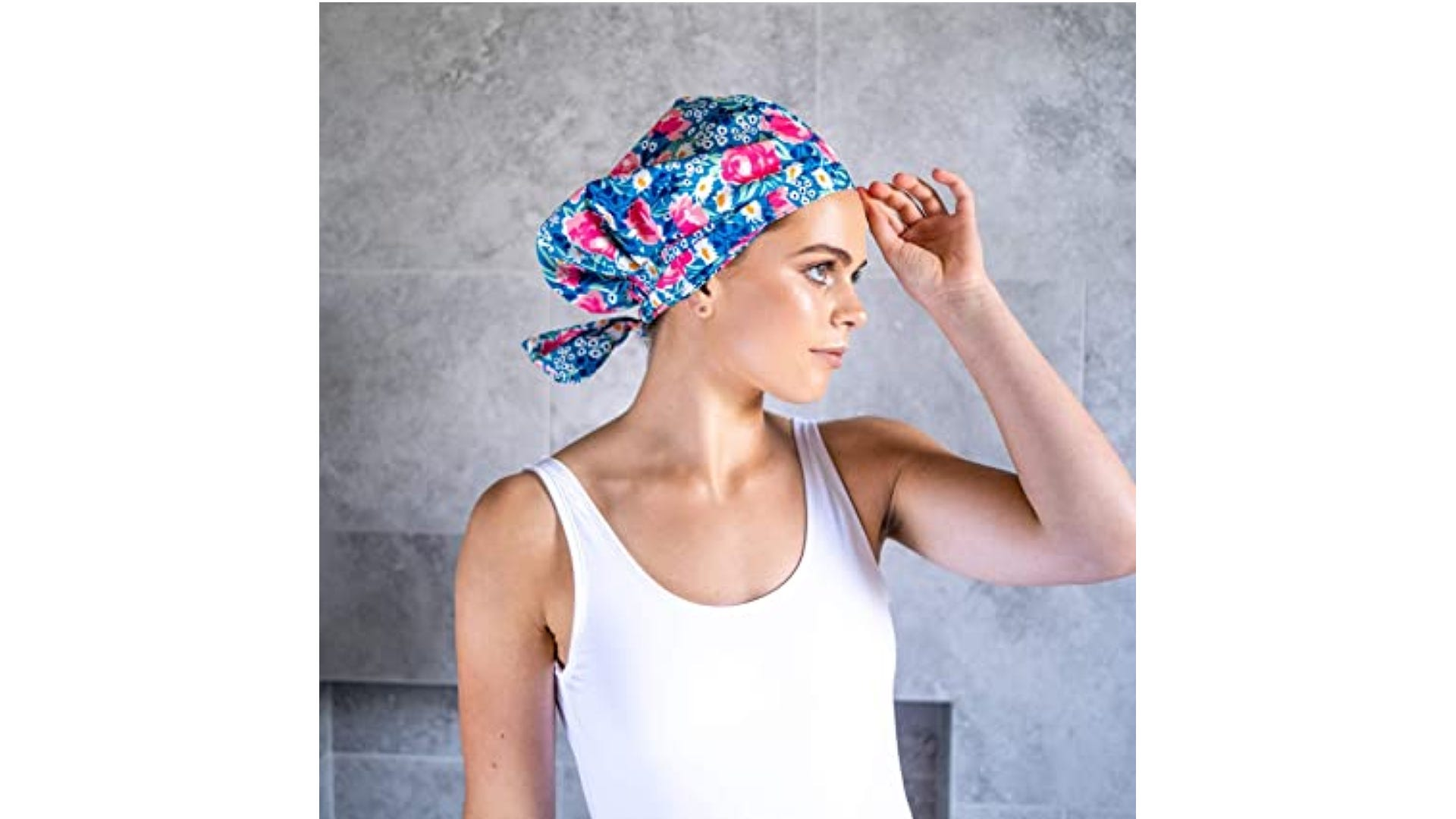 woman wearing blue and pink floral shower cap with tie